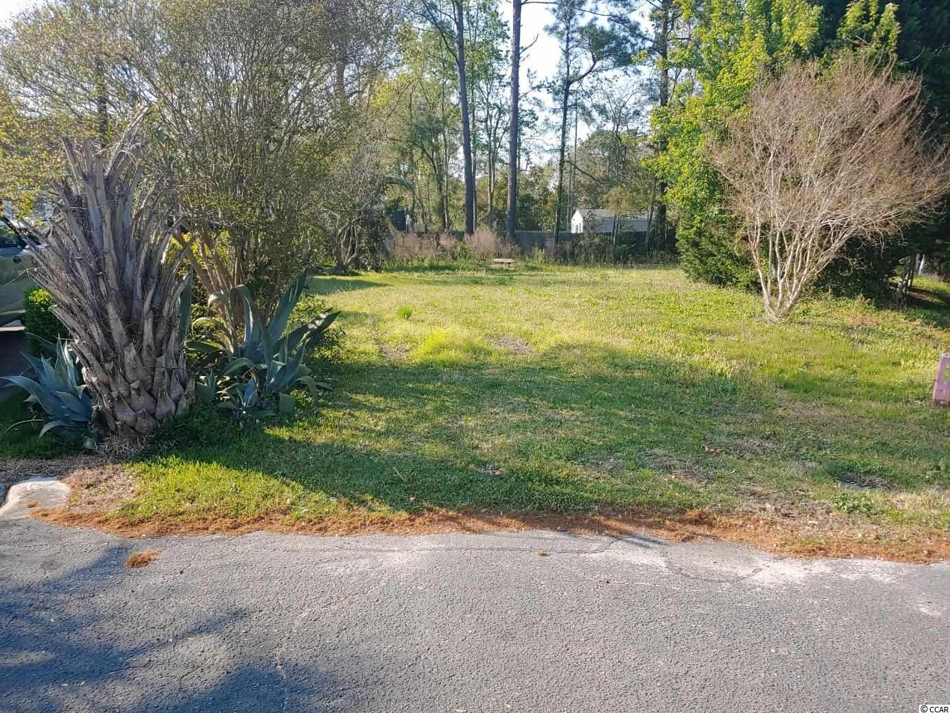 This lot is one if not only lot located in the much sought after Kings Grant in Murrells Inlet, and is a close distance to the famous Marshwalk, several golf courses, restaurants and the Atlantic ocean. There has been many improvements to the lot and is ready to build. Large pipe was installed in the back ditch and filled with topsoil to make lot larger and to improve drainage. Also large tree from center of lot removed and Fruit trees planted.