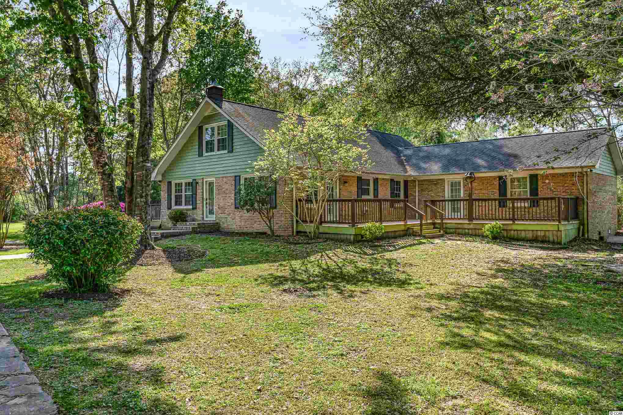 A RARE OPPORTUNITY TO FIND 2 ACRES IN MURRELLS INLET WITH NO HOA!  COME SEE THIS TREASURE.    YOU'LL  FEEL LIKE YOU ARE IN THE COUNTRY BUT CLOSE TO BEACH, SHOPPING, RESTAURANTS, THE MARSH WALK IN MURRELLS INLET AND MEDICAL FACILITIES.  SCHEDULE AN APPOINTMENT TO VIEW THIS UNIQUE PROPERTY AT 5613 ROSEHALL DRIVE. THIS BRICK 5 BEDROOM, 4 BATH HOME HAS ENDLESS POSSIBILITIES FOR YOUR LARGE FAMILY AND PLENTY OF ROOM FOR YOUR EXTENDED FAMILY.  YOU WILL ENJOY YOUR ESTABLISHED YARD WITH BEAUTIFUL AZALEA BUSHES, DOGWOOD TREES, PLUM TREE, FIG BUSH, BLUEBERRY BUSHES, GRAPE HARBOR AND 2 LIVE OAK TREES FROM YOUR 2 DECKS AND SCREENED PORCH WHILE HAVING YOUR MORNING COFFEE. BEAUTIFUL WOODED CEILING IN THE LIVING ROOM & DINING ROOM.  FIRST FLOOR MASTER SUITE (WITH GAS FIREPLACE) THAT INCLUDES SEPARATE SITTING AREA (WITH CLOSETS), THAT COULD ALSO BE USED AS OFFICE OR EVEN A NURSERY & A SCREENED PORCH OFF MASTER BEDROOM.  TWO MORE BEDROOMS ARE ON FIRST FLOOR: ONE BEDROOM WITH PRIVATE FULL BATH.  THERE ARE 2 LARGE ROOMS UPSTAIRS  (ONE BEDROOM FEATURES BUILT-IN SHELVES) AS WELL AS FULL BATHROOM.  ENTER INTO YOUR SPACIOUS LIVING ROOM (24'X21') WITH LOTS OF NATURAL LIGHT THAT LOOKS OUT TO YOUR DECK AND BEAUTIFUL BACKYARD.  THERE IS ALSO A (24'X21') FAMILY ROOM WITH GAS FIREPLACE & SEPARATE ENTRANCE OFF FRONT DECK.  THERE ARE TWO LAUNDRY AREAS OR ONE CAN BE USED AS A CLOSET.  THE INTERIOR HAS JUST BEEN PAINTED, FIRST LEVEL WOOD FLOORS REFINISHED, 2 NEW SLIDING GLASS DOORS IN LIVING ROOM, NEW LIGHT FIXTURES, ALL NEW WINDOWS AND DOORS, NEW KITCHEN SINK, KITCHEN COUNTERS REFINISHED, BATHROOMS UPDATED, 3 HVAC UNITS -- MAIN FLOOR UNIT JUST REPLACED. *HOT TUB, GUN SAFE AND BELL ON DECK DO NOT CONVEY.* LARGE DETACHED GARAGE/WORKSHOP WITH SCREENED PORCH WITH MANY USES (MAN CAVE, STORAGE)  AND AN ATTACHED SCREENED PORCH FOR A SUMMER KITCHEN FOR FAMILY COOKOUTS.  THERE ARE 2 DRIVEWAYS FOR PARKING AS WELL AS LOTS OF ROOM FOR RV, BOAT, CAMPER.  THIS PROPERTY LOCATED ON DEAD END STREET GIVES YOU PRIVAC