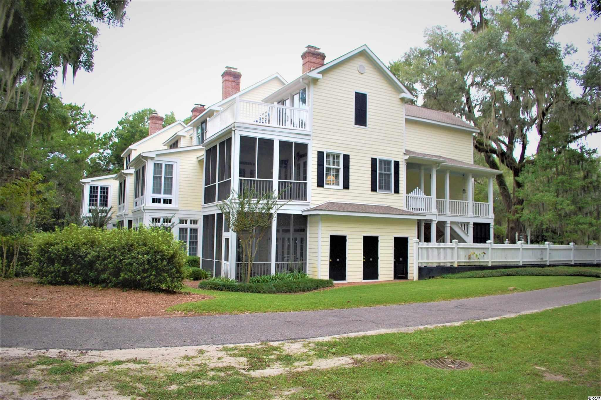 A large screened porch and a large Carolina Room off of the living room and the great room. Two fireplaces, one each in the living room and the great room. Hardwood floors and everything is in excellent condition . This lovely condo is in a beautiful and tranquil setting overlooking the 18th fairway, the lake and the Waccamaw River/ICW!