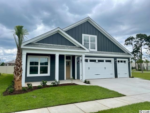 Our fantastic new Emerald 4 with Rear Porch Model has so much to offer ~ This One & 1/2 story home features 4Br/3Ba with office on first floor & 1 BR/bonus with full bath on the 2nd floor and a large 3 car garage! This open floor plan boasts a large living room, breakfast/dining area, kitchen with free standing gas convection range, over-the-range sensor microwave, energy star dishwasher, granite countertops, garbage disposal, pantry, laundry room & rear covered porch. Fantastic Master Suite with tray ceiling, 2 walk in closets & bathroom with walk in shower, water closet and his & her sinks. The 2nd floor boasts a large bedroom/bonus room with full bath. Energy savings features include Low E windows, 14 Sear HVAC, Digital WiFi Programmable Thermostats, Tankless Gas Hot Water Heater & 200 Amp electrical service, security system with keyless entry.  Too much to mention so come see for yourself! From the time you step onto the quaint from porch & open the front door you'll see the quality of construction. 9' flat ceilings, wide plank restoration flooring, luxurious carpet in bedrooms.  Additionally, Robber's Roost at North Myrtle Beach is a natural gas community east of Hwy 17 with a community pool coming for the 2021 swimming season & is located within walking, bicycle or golf cart distance to Tilghman Beach, the beautiful Atlantic Ocean w/ 60 miles of white sandy beaches and is close to Coastal North Town Center (shopping, dining, beauty, pets), Shag dance capital Main St., golf, boating/fishing in the ICW, entertainment and all the amenities of living in Coastal South Carolina. Whether a primary residence or your vacation get-a-way, Don't Miss ~ come live the dream!  (*Many new plans to choose from!)