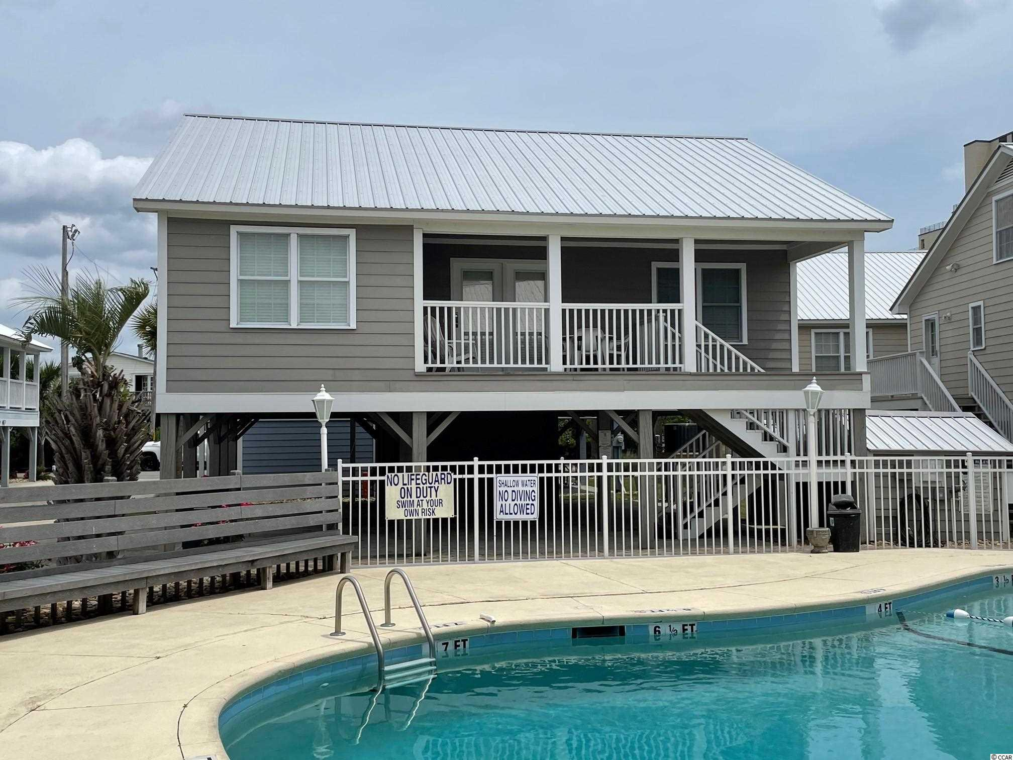 Looking for a great beach get-away?  This quaint cottage is a 3-bedroom, 2-bathroom unit located in the second row community known as Summer Winds.  Unit #11 has a metal roof, is located directly next to the community pool and just a short walk to the beach.  The back porch was enclosed to create a second living area/den and can be used as a separate TV room.  New heat pump was installed in May of 2020.  Unit is on a rental program and is booked for the 2021 summer season!  Contact the listing agent, or your Realtor, for information on the rental history or HOA fees, etc.  Check out the Matterport 3D Virtual Tour here: https://my.matterport.com/show/?m=p1Jy54L7cRK&brand=0