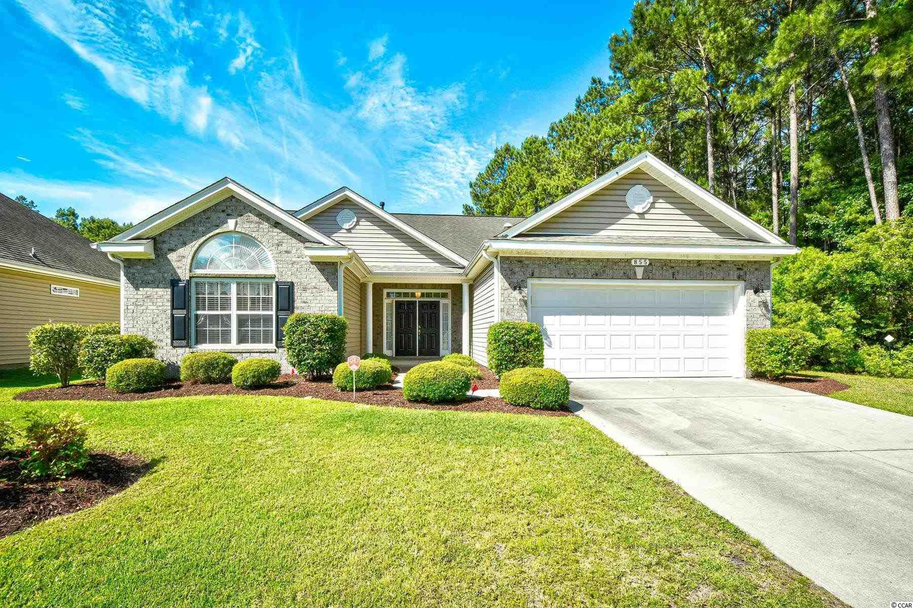 Welcome home to this beautifully upgraded 3 bedroom, 2.5 bathroom home in the quiet 55+ community, Myrtle Trace Grande. This home features a grand entryway with a spacious open floor plan of the main living areas, with a fireplace as a main focal point. The kitchen is equipped with all stainless steel appliances, granite countertops, plenty of cabinet and counter space with an additional work island, a breakfast nook, and a breakfast bar leading into the formal dining area. Each bedroom offers a ceiling fan, plenty of closet space and easy access to a bathroom with double sink vanities in each, while the master bedroom also offers tray ceilings, room for a seating area, a large walk in closet, and private master bath with an oversized garden tub and walk in shower. A Carolina room can be used as an office space or additional living area. Furnishings are negotiable with sale, washer and dryer are included. A two car garage adds ease and convenience, and a preserve area on one side means no one can build right next to you! Enjoy afternoons in your screened in patio, in your backyard with manicured landscaping, or relaxing at the community pool, with all of the area's finest dining, shopping, golf, and entertainment attractions close by. Make this your forever home. Schedule your showing today!