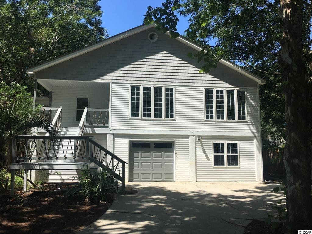 One in a lifetime opportunity to own walking distance to Murrells Inlet famous marshwalk. Beautifully remodeled 5bedroom/4bath raised beach house with income producing 1 bedroom apartment and in-law quarters both offering separate entrances. This property is in the heart of Murrells Inlet and steps away from the famous Marshwalk. Cash-cow for any investor or live in one unit and rent the rest out. This is a excellent income producing property with a proven track record.  The property speaks for itself.