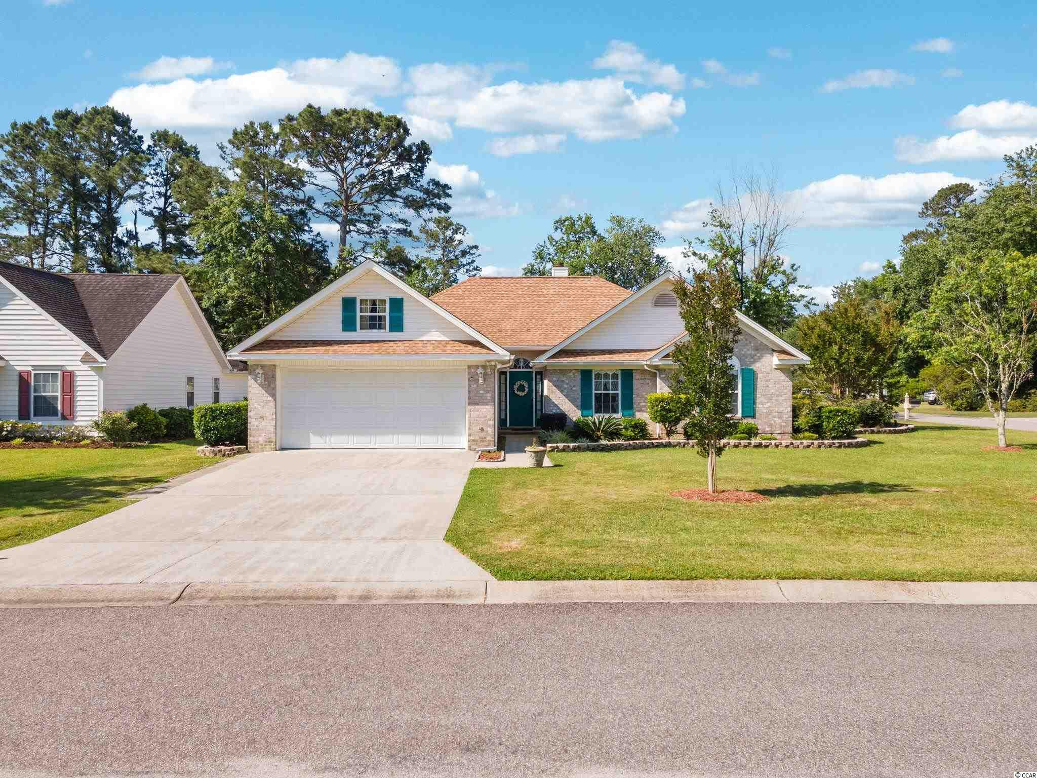 Welcome Home!  Charming home on a beautiful corner lot in Indigo Creek in Murrells Inlet!  This home not only has a family room but a den/tv room and an enclosed sunroom that has heat and air conditioning that was added in 2002.