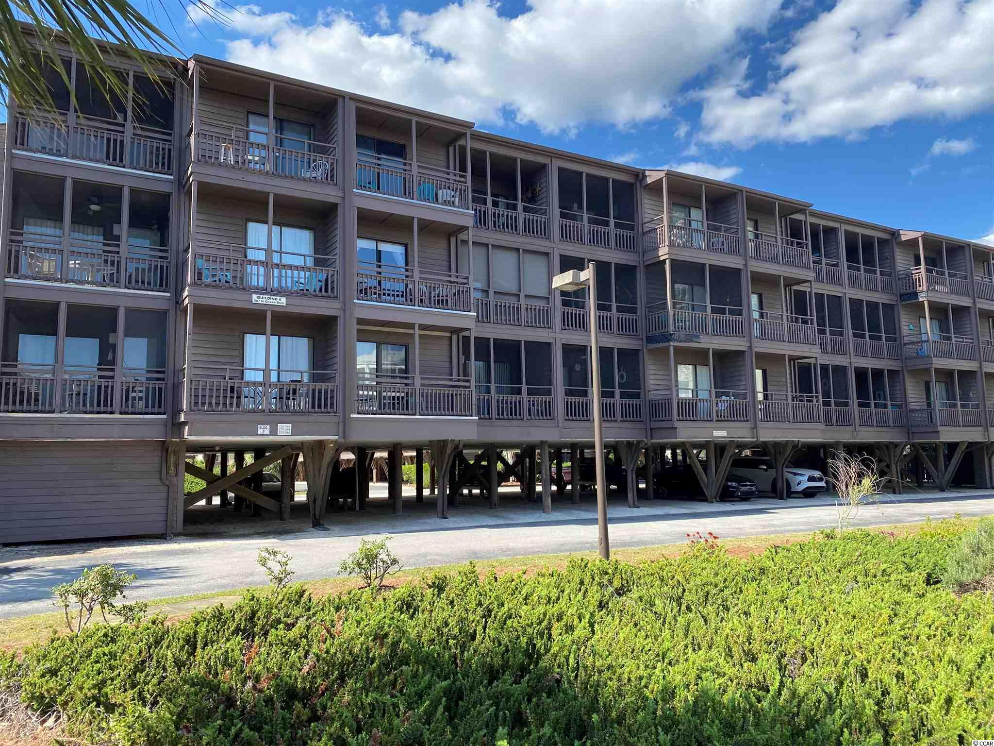 """Here's your chance to own a top floor end unit overlooking Ocean Blvd in the """"Ocean Drive"""" section of North Myrtle Beach.  You'll enjoy the high ceilings, skylight and extra windows of the end unit. Tilghman Beach and Racquet 339 has 3 bedrooms with 2 full baths and 1 half bath.  Some upgrades include the hot water heater, living room furniture, TV's, fresh paint and cabinets in the bathroom.  Watch the activities along the boulevard from your private balcony of the master bedroom or screened balcony off the living room.  No need to worry about stairs, the elevator is close to this unit.  Enjoy the amenities of the resurfaced tennis courts and pool just behind the building or the sandy beach and ocean are across the street.  Also you are just 2 blocks to """"main street"""" Ocean Drive and just a short drive to dining, shopping, entertainment, golf, and all the Grand Strand has to offer."""