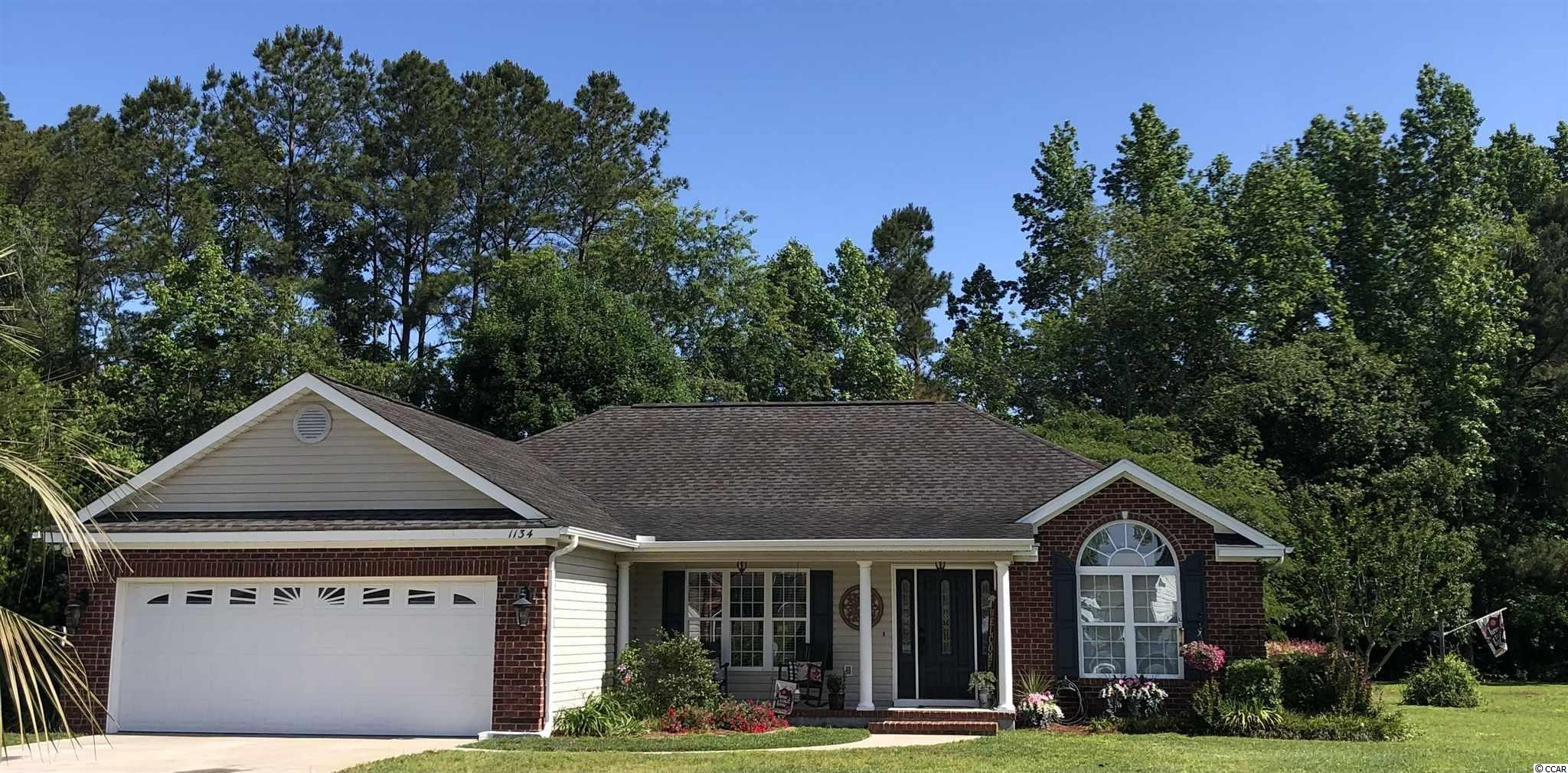 Stunning, split plan, 3 BR/2 BA, attached, double car garage, brick front home on .786 acres located just outside the city limits of Conway (only county taxes). Custom maple, cherry stained cabinetry, stainless steel appliances, hardwood floors in foyer, dining area, family room and hallway. Kitchen, laundry room and both lavatories have distinguished and very stunning stamped concrete flooring. Exquisite gas fireplace focused in the family room and designer paint colors freshly painted throughout this home.  Carpet in both bedrooms was also recently professionally steam cleaned.  The inground sprinkler system allows for the lush landscape and the landscape curbing enhances this homes already remarkable curb appeal. All buyers must view this spectacular home, as it may be just for YOU!!  NO HOA!  The detached storage 12 x 16 storage building also conveys with the property.