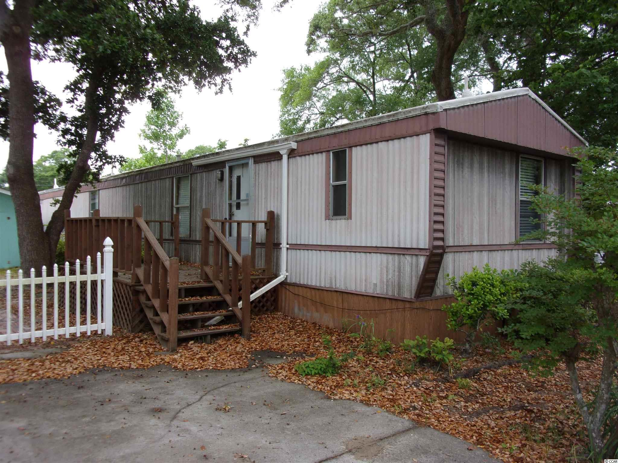 Nice 2 bedroom 2 bath 1984 Vogue 14 X 67 single wide manufactured home with an room addition added. Must see to appreciate. No HOA and short golf cart ride to beach.  Has front deck and side deck and storage building as well.   SQUARE FOOTAGE IS APPROXIMATE AND NOT GUARANTEED. BUYER IS RESPONSIBLE FOR VERIFICATION.