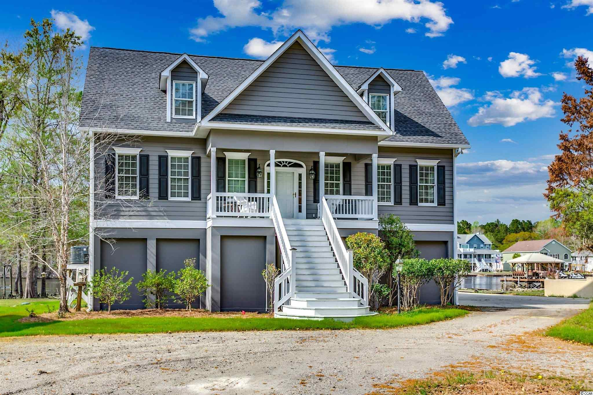 This adorable waterfront home located directly on the Intracoastal has a spacious 2,953 heated square feet, 4,931 total square feet layout with an unbelievable 12-foot Anderson Bi-parting sliding door opening up to your 50' long and 12' wide 600-square foot back deck overlooking the waterway. There are a pair of master suites and a total of four bedrooms, 3.5 bathrooms with a separate office. Wait until you see the first floor master bedroom. It is gorgeous. It has direct access to the deck, includes an en-suite bathroom with a tiled walk-in shower, his and her walk-in closets, jacuzzi tub double granite vanities, separate water closet and a linen closet. The kitchen is equally impressive and includes upgraded stainless steel appliances, granite countertops, pantry, built-in desk and custom cherry kitchen cabinetry. This beautifully decorated house is a must see and a must have home for anyone, which also includes a first floor formal dining room with tray ceilings, high-end Hinkley lighting, a pre-wired and plumbed wetbar for future use, customized Anderson windows and doors throughout and is wired for surround sound and distributive audio. Finishing off the 1st level living space is a gas fireplace in the living room, enlarged laundry room adjacent to the kitchen with an utility sink, a separate 400-foot square foot bonus room that is heated and cooled, plus two hot water heaters, or possible elevator space and ample storage in the attic, garage and closets. This home provides the customized touch with custom wide oak plank flooring in the common areas, customized two-piece molding on all windows, a customized staircase and doors as well as customized two-piece baseboard molding. This home is convenient to great schools and shopping. This impeccably landscaped home also includes a whole yard sprinkler system. There is a bounty of parking for your cars, up to six(6), and a (4) four-bay garage with an enclosed workroom/game room with about 400 square feet that is he