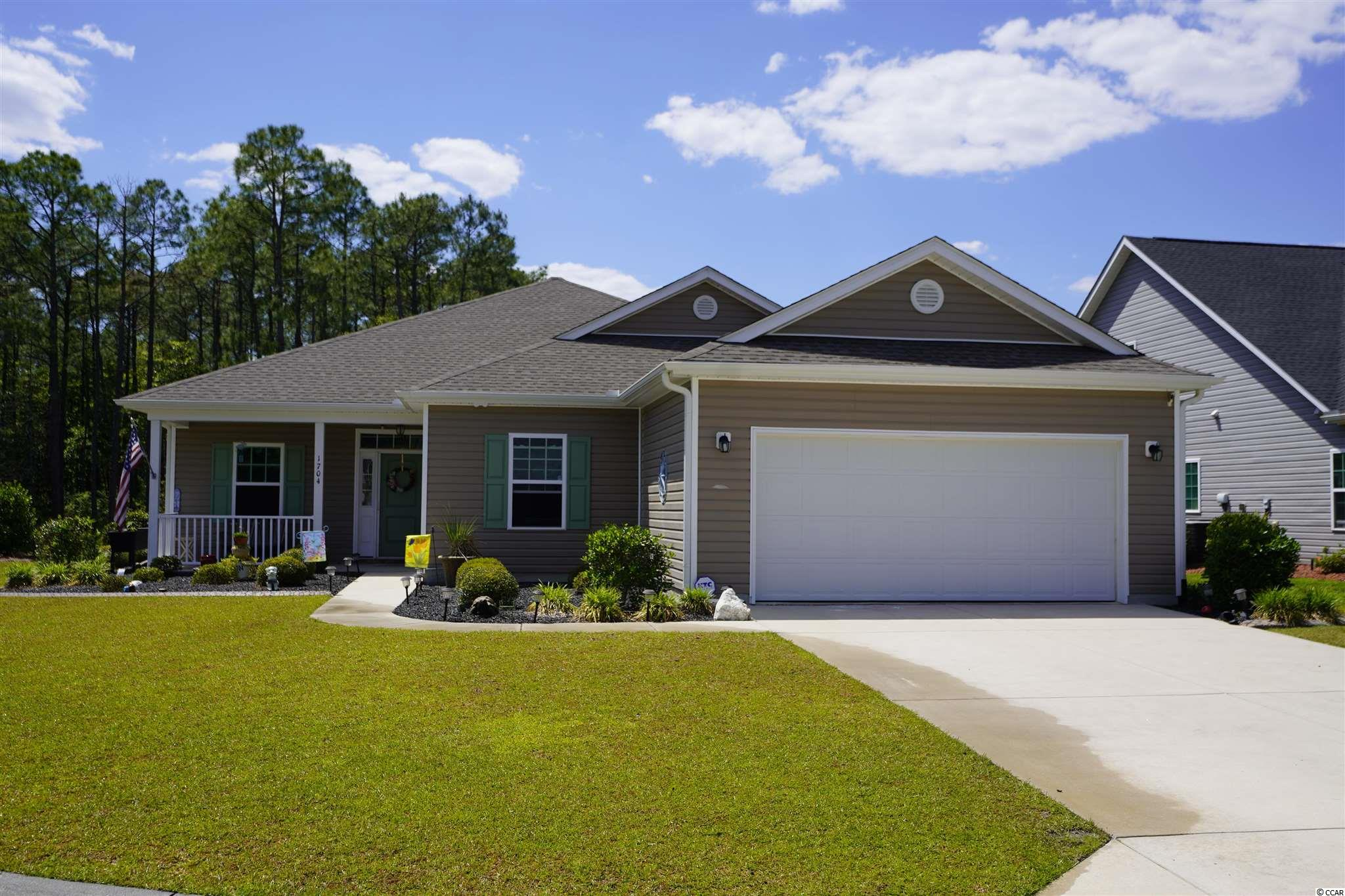 Located just 15 minutes from the beach with quick access to Hwy 31 is this 3 bedroom, 2 Bath home. This is the Welbourne Floor Plan built by RS Parker Homes in 2015. The home features tile, wood and carpet flooring, granite countertops, ceiling fans in all bedrooms and living room and a propane gas fireplace in the living room.  This home also has a very spacious covered screen porch, finished garage, whole house surge protector, fenced back yard, curbscaping, irrigation system and is located on a cul de sac street. The community has a pool, clubhouse and kids playground located just a short distance from the home. All appliances convey including washer and dryer (except deep freezer and refrigerator in garage). The home has great curb appeal and is a must see!! Call to schedule an in person viewing of this lovely home.