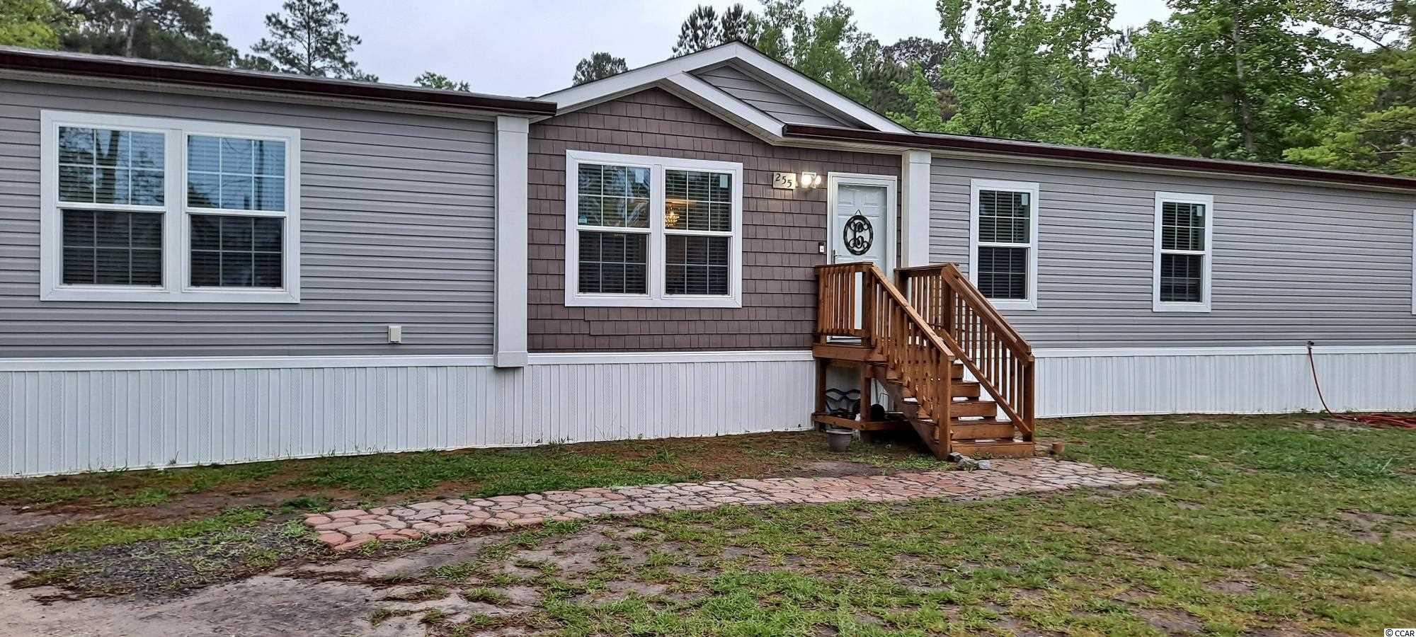 Lovely and spacious four-bedroom two bath home with a living room area, a den area, and a very spacious laundry room that includes a utility sink. There is also a nice deck and large backyard on approximately an acre of land. Within approximately two miles to Harris Landing boat ramp. This property has been de-titled and is also connected to county water and sewer. Square footage is approximate and not guaranteed. Buyer is responsible for verification.