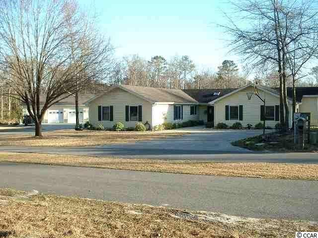 Located in the much sought after neighborhood of Nottingham Lakes, and less than 15 min. from Myrtle Beach, SC. This home is a need of someone that is looking for a fixer upper. Nestled on a cul-de-sac in the rear of the subdivision, you will find peace and tranquility on this rare large double lot that is over 3/4 of an acre. This spacious 4 bedroom 3 bath home also includes a bonus room that could be utilized as another bedroom, game room, or home office. The formal dining area is next to a large kitchen with a work island that could be perfect for a large or growing family. In the back rests a large covered deck with a spacious back yard. A massive 30 X 45 detached 3 car garage sits just to the side that is perfect for storage, and/or private hobby area. A true diamond in the rough.