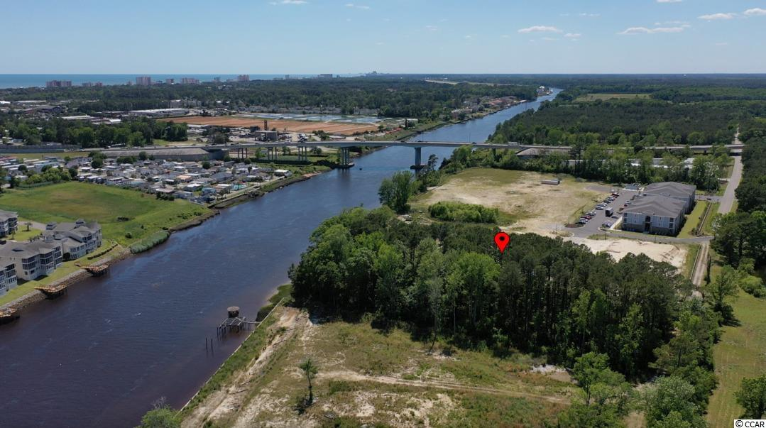 Presenting this peaceful .83 acre wooded lot located with 79 feet directly on the Intracoastal Waterway. NO HOA. No time limit to build so come and build your dream home with your chosen builder in your time frame. Effortless connection to Robert Edge Parkway. This lot affords you easy access to the beach and golfing along with all of the other activities and happenings in North Myrtle Beach & Myrtle Beach including fun eateries, award winning off-Broadway shows, public fishing piers, and intriguing shopping adventures along the Grand Strand. Conveniently located to your everyday needs, including grocery stores, banks, post offices, medical centers, doctors' offices, and pharmacies.