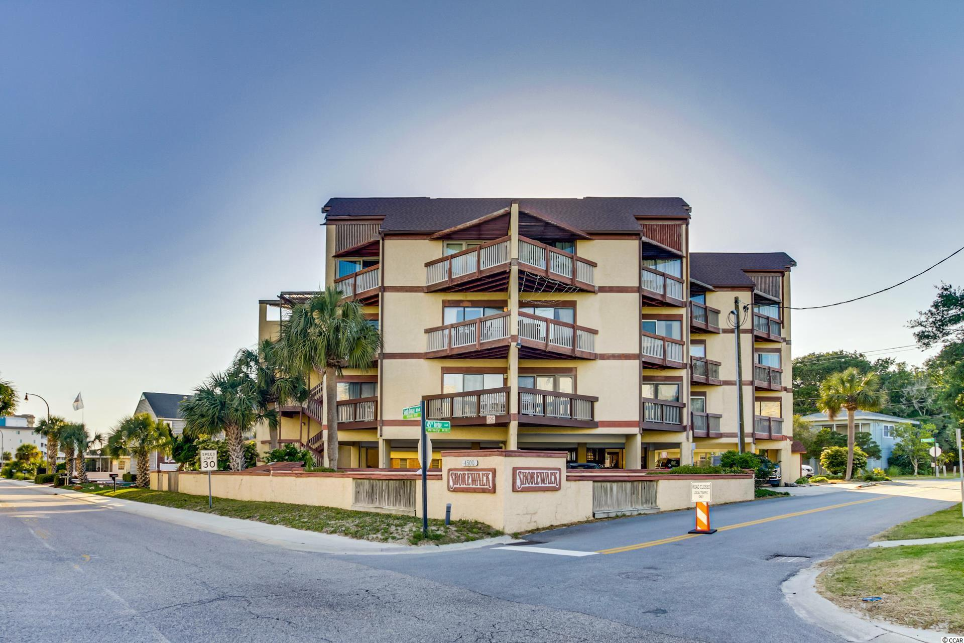 What an opportunity to own a beautifully renovated ocean view condo, second row, located in the Windy Hill Section of North Myrtle Beach.  There are so many extras in this unit, and the renovation is spectacular.  The kitchen has all new kitchen cabinets, granite countertops, touchless kitchen faucet, beautiful tile flooring throughout, all new Whirlpool stainless appliances, including a double oven, a wine fridge, beautiful farm sink, and a custom cabinet in the kitchen with large drawers for storage.  There is a new washer/dryer.  Both bathrooms have been renovated, including new plumbing in the walls, comfort height toilets, with new tile showers, hall bath has rain shower shower head while the master bath has a barn door entrance.  The living room has crown molding, and has a new queen sleeper sofa for those extra guests, along with all brand new furniture and a new flat screen TV.  The master has a king bed and the second bedroom has a queen size bed.  This is an elevator building, so having a unit on the top floor with no one above you is the best.  You will have to see this unit to appreciate the renovation.  Come and find your place at the beach with close beach access, you will be glad you did!