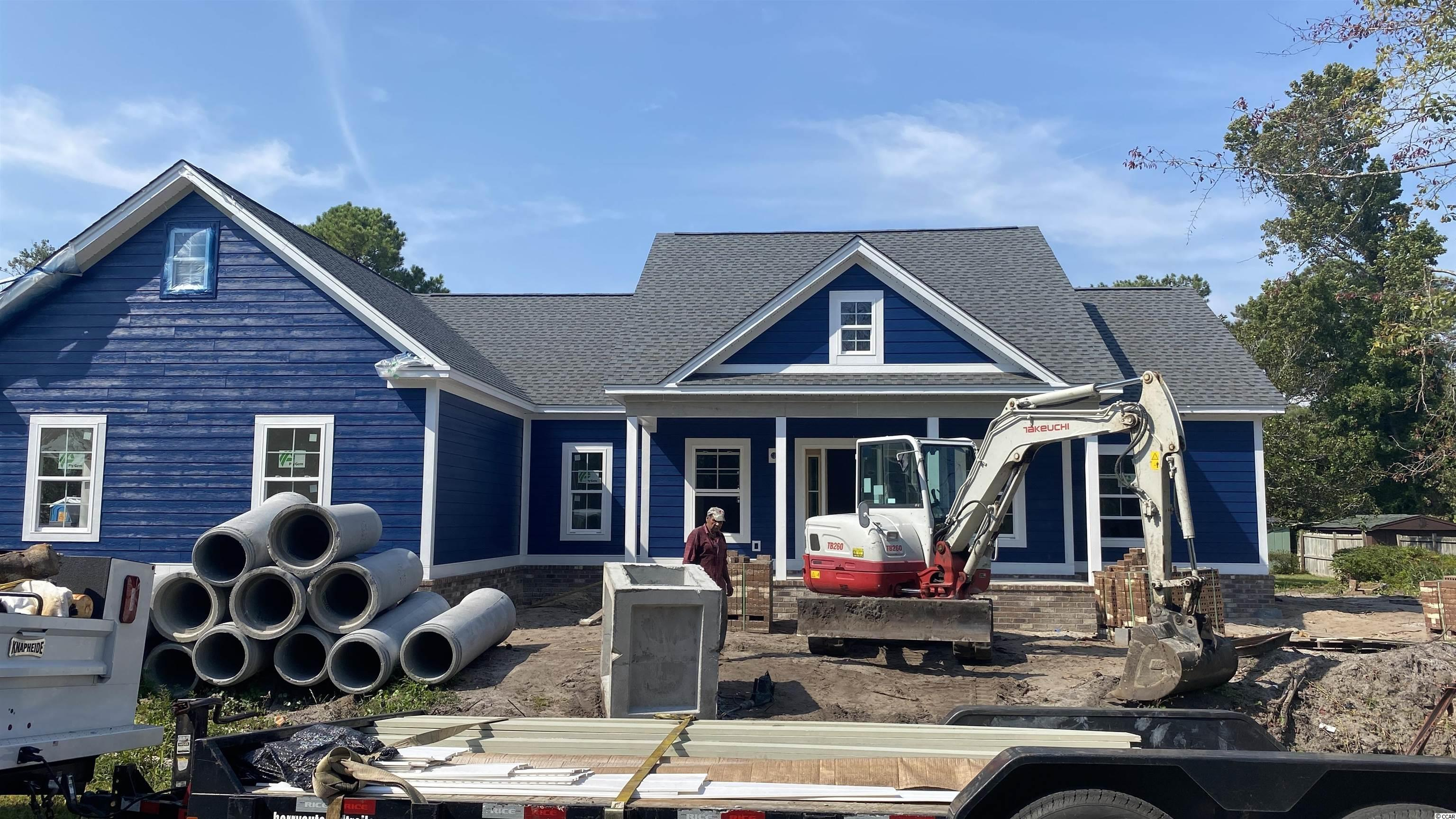 Construction has just begun on this charming, 3 bedroom home located in the heart of North Myrtle Beach in a NON HOA, well established community.    This split bedroom, open floor plan with 9' ceilings throughout.  The en suite features tray ceilings while the bath has double vanity sinks and a custom tiled shower.  The well designed kitchen features granite countertops, stainless steel appliances, and an open concept breakfast bar overlooking the dining area and great room.  The great room has a gas fireplace and dramatic tray ceiling. Most evenings will be spent on the  240 sq ft rear porch, overlooking the landscaped lawn complete with in-ground irrigation system.  Check this one out today!
