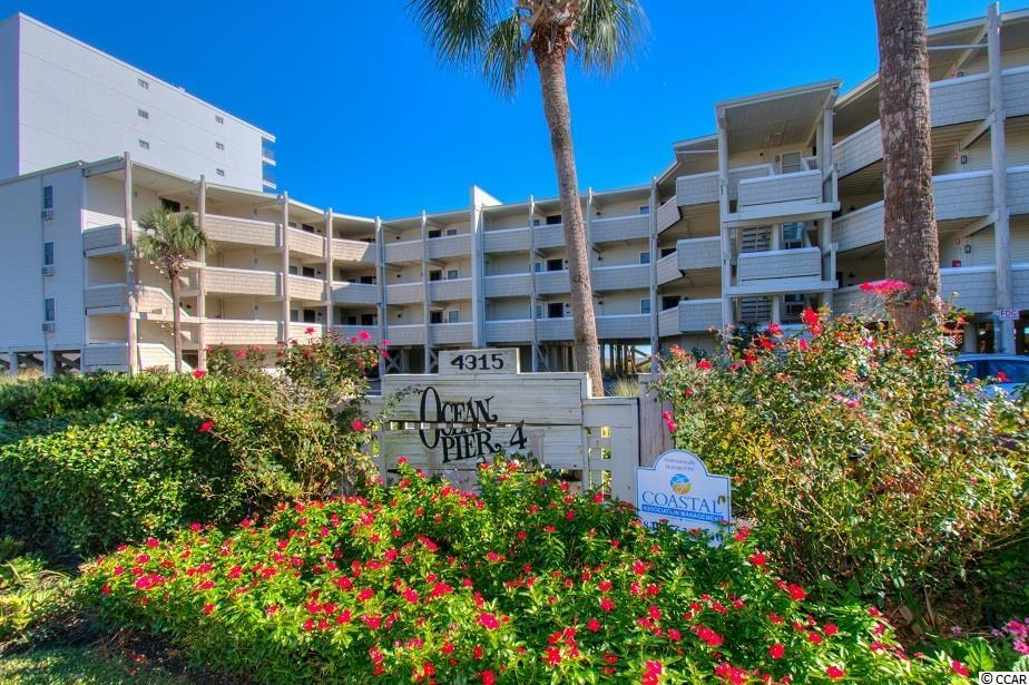 First floor, direct oceanfront 2-bedroom, 2-bath unit in Ocean Pier IV in the Windy Hill section of North Myrtle. This income-producing condo is being offered completely furnished and has a king bed in the oceanfront owner's suite, two twin beds in the 2nd bedroom, a pull-out queen sleeper sofa in the great room, 3 flat-screen TVs, stackable washer & dryer and more. Ocean Pier IV offers an oceanfront pool with reasonable HOA fees and is located close to Barefoot Landing. Schedule your showing today!