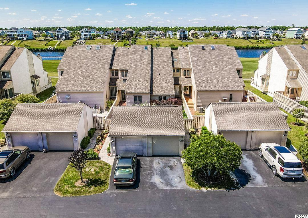 FORE!!! Welcome home to this freshly updated 3BR/3BA Townhome that is located on the golf course overlooking the Intracoastal Waterway in the beautiful, highly sought-after Fairway Lakes community within Plantation Point in the heart of Myrtle Beach.  Located within a couple of miles of some of the best beaches, dining, shopping, entertainment and golf that the Grand Strand has to offer. Use this as your permanent home, your second home at the beach or as an investment property. This home provides a single car detached garage with its own private courtyard leading you right to the front door.  Also, it has been updated with brand new flooring, new kitchen cabinets, countertops, all stainless appliances, new vanities, lighting and fresh paint throughout. In the living area is a nice Fireplace for those cooler nights. Community swimming pool and tennis courts are located just steps from your door.  On the second floor is the laundry area with hookups for a standard size Washer and Dryer. This home won't last long so please phone your agent today! All measurements and square footage are approximate and must be verified by the buyer.