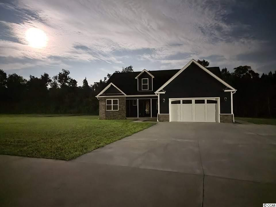 USE 1076 Spring Garden Road Conway, SC for GPS location since this is a new road. 1.36 Acres, NO HOA, Aynor School District, New 10 home community, concrete road. 5 bedroom, 3 full baths, game room with sitting room, 2,689 heated square feet (1,798 first floor, 891 2nd floor), 240 square feet screened in porch with 12 foot ceiling. 562 square feet fully insulated garage with storage closet and WiFi smart garage door opener. Custom built cabinets, granite counter tops, oil rubbed bronze finishes, upgraded insulation, double sinks in all 3 bathrooms, tile shower and stand alone claw foot soaker tub in master bathroom, large bedrooms, and SO much more! A must see to get all the upgrade details! Aries Custom Homes - Horry Independent Winner Best Home Builder 2 years running! 20+ years experience Custom Home Builders, family owned, and operated. Quality, less maintenance! Other lots, .82 acre and up available, plenty of house plans to choose from.