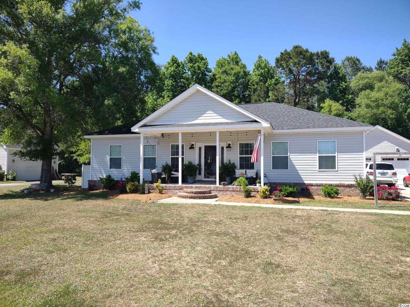 Great low-country style home with granite countertops, SS appliances, large screen porch facing the back yard. 30 x 24 detached 2 car garage with 3 bedroom & 2 baths!!!