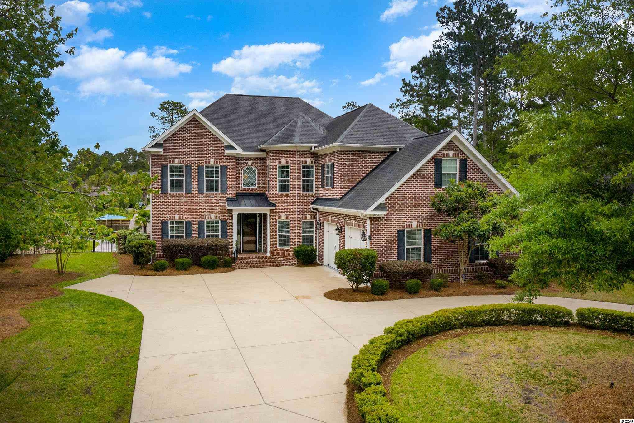 This amazing all brick home is situated on 0.42 acres just minutes to Conway Medical Center and Coastal Carolina University and also a short drive to Myrtle Beach. Forest Lake Estates is a quiet community with limited traffic and a private gated entrance onto Myrtle Ridge Road as well as access of off Hwy 501 at the Burning Ridge Golf Course entrance. You're welcomed to the home with a circular driveway and oversized side load garage. The owner remodeled the kitchen, master bath, and den in 2019. Downstairs you'll find an office, bedroom with private full bath, den and a great room with a soaring ceiling and beautiful stacked stone fireplace surrounded by custom built in shelves. The den also features custom built in cabinetry. The kitchen is well laid out with lovely custom cabinetry, work island, tile backsplash and stainless appliances. The kitchen is adjoined with a spacious breakfast nook and formal dining room. Upstairs is a luxurious master suite with a sitting area and fireplace, and walk in closets of your dreams. The master bath was a complete remodel and is like a 5 star spa. There are 2 additional bedrooms and a bath upstairs.  The laundry room is also upstairs with cabinetry for storage and counter space to make the room very functional.  A heated 14 x 37 pool with hot tub and waterfall were also added in 2019 along with an outdoor kitchen. The backyard is completely fenced with black aluminum with 3 gates, and a play area fenced separately from the pool. There is an irrigation system with its own water meter for cost efficiency. The outdoor space is perfect for a relaxing evening or to entertain guests. There's easy access to Hwy 544 and 501. What's not to love! It's perfection inside and out!