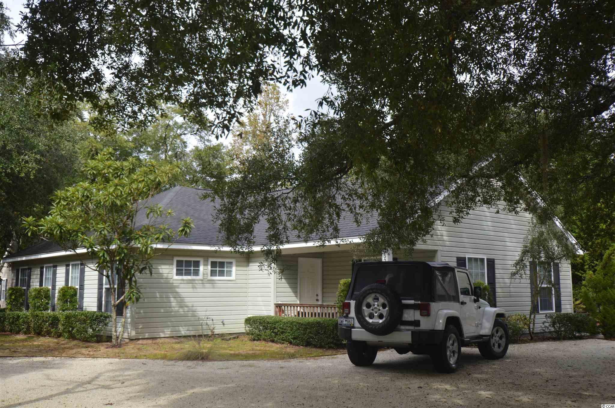 Minutes away from the beach!  Just a golf cart ride away or a bike ride!  Built in 2008 by owners.  Live on one side and rent the other!  No HOA! Not in a flood zone. It doesn't get any better!! Very well maintained.