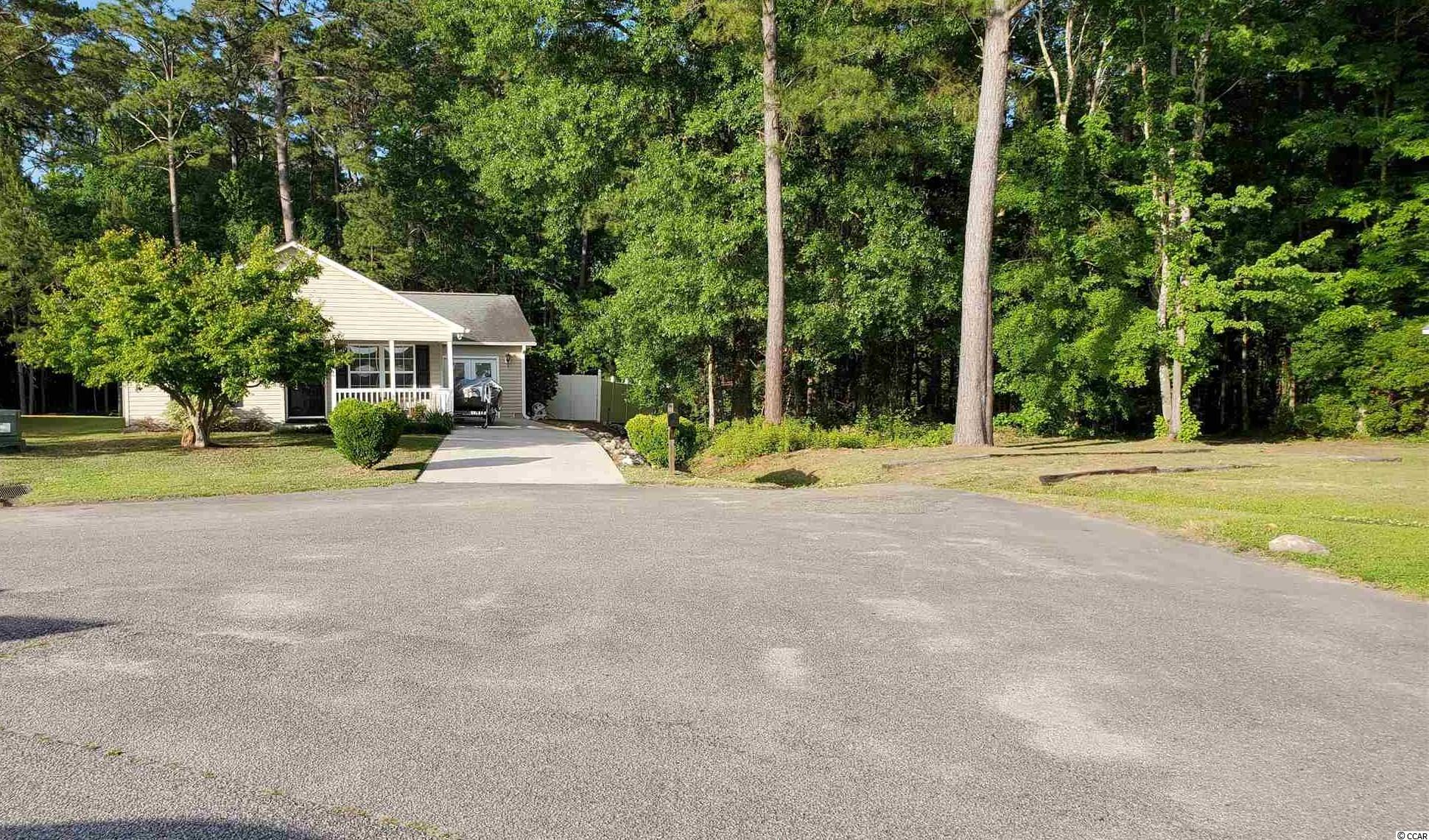 This charming home has a lot to offer! You have a rare chance to own a home in Murrells Inlet in the highly sought after Saint James school district on a pond with trees behind and to the side.  All the nature lovers out there will adore this home on this .22 acre lot!  This 4 bedroom home has over 1,650 heated square feet making it a great home to have a large family or even run a business from home.  The private fence encompasses almost a 200 square foot shed for storage, firepit and a nice view of the pond.  You can fish right from your back yard! This pond is stress free as the water overflow flows from the back of the pond to the forest behind. This low traffic area in the very back of the neighborhood makes it a nice place for children to play, throw the ball or ride a bike. This home is also on a semi-cul-de-sac giving you extra space in front of your home.  The lot location is unmatched in this neighborhood.  The kitchen is a good size with a island to give the chef room to work.  The stainless steel appliances are a nice touch as well.  The converted 1 car garage can be used for a 5th bedroom, den, bonus room, office or whatever you would enjoy.  There is a 140 sq ft screened in back porch with a ceiling fan to ensure you will be enjoying all of those beautiful Carolina days.  The home is located only 10 minutes to the beach, the famous restaurant row on the Inlet, shopping and even less time to the International Coastal Waterway.  Location, location, location! This home is truly a must see!!  Book your showing today!  Buyer is responsible for the verification of all measurements.  Copy and paste this link in your browser for a virtual tour:  https://youtu.be/kjTiXpuRy_o