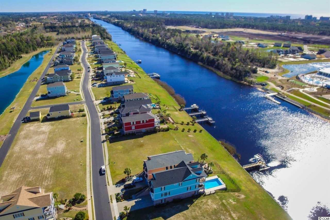 DIRECT WATERFRONT LOT - -  Enjoy incredible waterway views for your new home-site located in The Battery on The Waterway in the highly sought after Carolina Forest Area of Myrtle Beach. The Battery is a private gated, custom home community situated along the Intracoastal Waterway! This secure neighborhood consists of Luxury Lowcountry Style homes with only 99 homesites that is affectionately surrounded by county parks and greenspace! In fact, Queens Cove and The Hulk (hiking and biking trails) are located just outside of the entrance to the community, perfect for those who love the outdoors. The ocean is only a 3.5 mile bike ride on a paved trail, as well. Amenities offered at The Battery include : Private Boat Storage , Day Docks on the Waterway, Boat Launch, A Waterfront Gazebo, and even a Basketball Area! Do you love this home-site, but prefer something a little more turn key ? If so, be sure to contact your agent for more information on our custom home concierge service