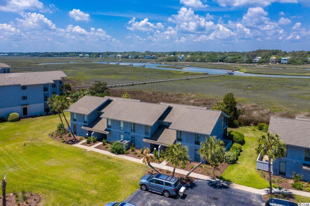The best of both worlds! Short walk to the beach - direct marsh/creekfront views and access. This newly renovated - fully furnished 3bedroom, 3.5 bath villa has been designed with all the comforts to truly enjoy the coastal lifestyle. An inviting foyer leads to an updated kitchen, breakfast bar/ dining area that leads to a screened porch. The spacious living room offers terrific views of the tidal salt creek and marsh. The large master bedroom has a lovely master bath and a porch for enjoying beautiful sunsets over the creek. The two additional bedrooms have amazing views. Just a short walk away is a large community pool and the walkway to the beach access. Inlet Point has a generous covered community dock with sitting areas and floating section for kayaking, boating, fishing, crabbing and all the creek fun you can stand! This villa invites family fun all year long!