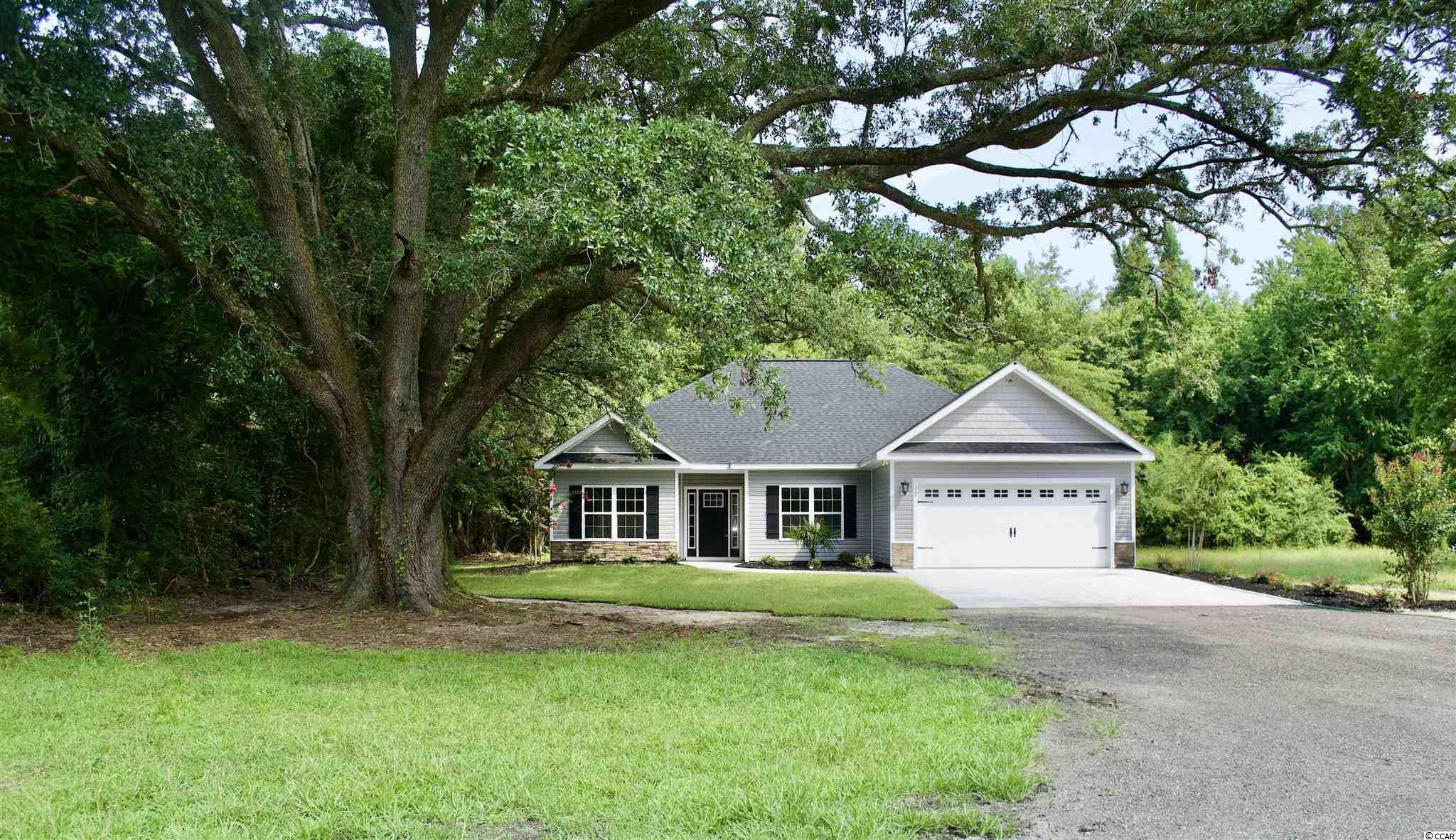 This beautiful custom built home sits on .60 acre lot with large century old live oak trees and just a few minutes from downtown Conway. Expect fantastic upgrades throughout, the kitchen will boast white shaker style 42' cabinets with oil rubbed bronze handles and feature soft closed drawers, granite counter tops with a tile backsplash and stainless steel appliances. Luxury wood vinyl flooring will be throughout the home. The 4th bedroom is designed to be a multifunctional room that could be used as a home office or a formal dining room and boast beautiful french doors. Some other home features will include shiplap wall accents, trim package, fireplace, upgraded tile shower, 10ft. ceilings, security system, Carolina room with an outside patio area. Located just a few miles from shopping, dining, waterfront and everything downtown Conway has to offer. Don't miss this opportunity. Schedule your showing today!