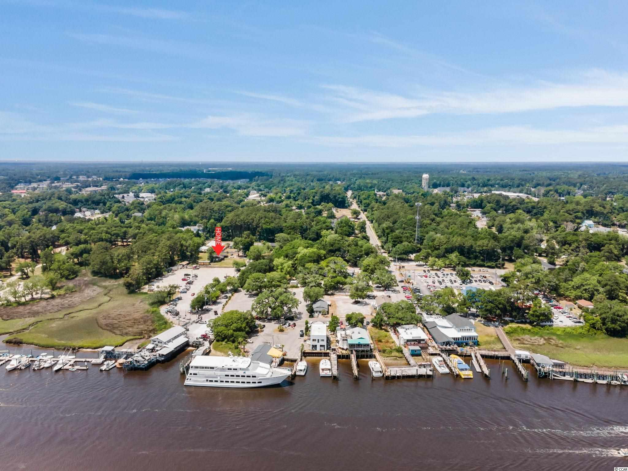 This is an incredible rare opportunity to own 3 lots close to the Intercoastal Waterway. Walking distance to The Big M Casino Boat and some of the best seafood in town makes this location unbeatable. The property is zoned PDD, so let you imagination run wild on the possibilities. Every May, this street host the Words Famous Crab Festival. Own a slice of paradise filled with opportunities. Just minutes from the heart of Myrtle Beach, and a short distance from the North Carolina line lets you have the best of both worlds.