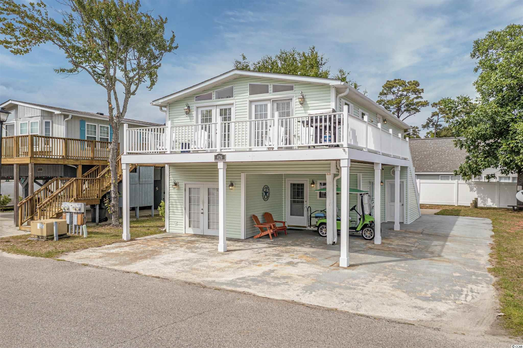 This beautifully presented raised beach home is full of coastal charm and comes adorned with custom features and upgrades throughout. Featuring an open layout with a spacious living area, 2 Bedrooms and 2 Full Bathrooms on the Main Level. In the heart of the home you will find a fabulous kitchen- perfect for entertaining. The generously proportioned interior flows effortlessly from living space to the wraparound deck where you can relax and unwind. On the lower level you will find a separate 2 Bed/1 Bath apartment with a full kitchen, large living/dining area, and a patio. This lovely turn-key home is being offered furnished and ready for you to enjoy for your personal use and/or investment opportunities. Set amongst manicured grounds within a private oceanfront community where you and your guests can enjoy resort-style amenities that include, indoor/outdoor pools, kiddie splash zone, hot tub, tennis/basketball courts, dog park, fitness center, private beach access, and much more. Located in Surfside Beach within walking distance to the beautiful sandy beaches, eateries, and local shops. Schedule your showing today.