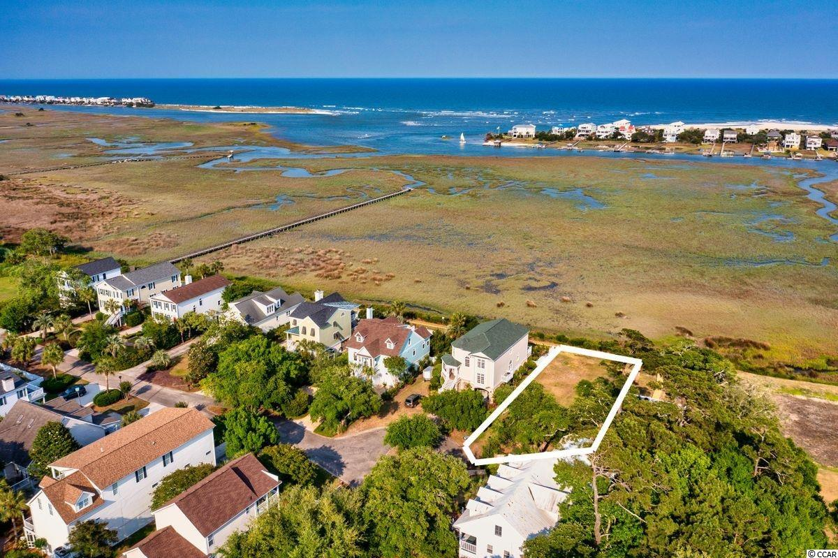 Only remaining marsh front lot in Oak Lea! This amazing residential lot boasts views of both marsh and ocean. Oak Lea gated community is situated in Pawleys Island and offers great amenities including a pool, tennis courts, and extension into Pawleys Island creek where home owners can enjoy kayaking, fishing and swimming. The view from this lot is breath taking and wont last long! 283 Berry Tree Ln could be the perfect location for that dream house you have been wanting to build!