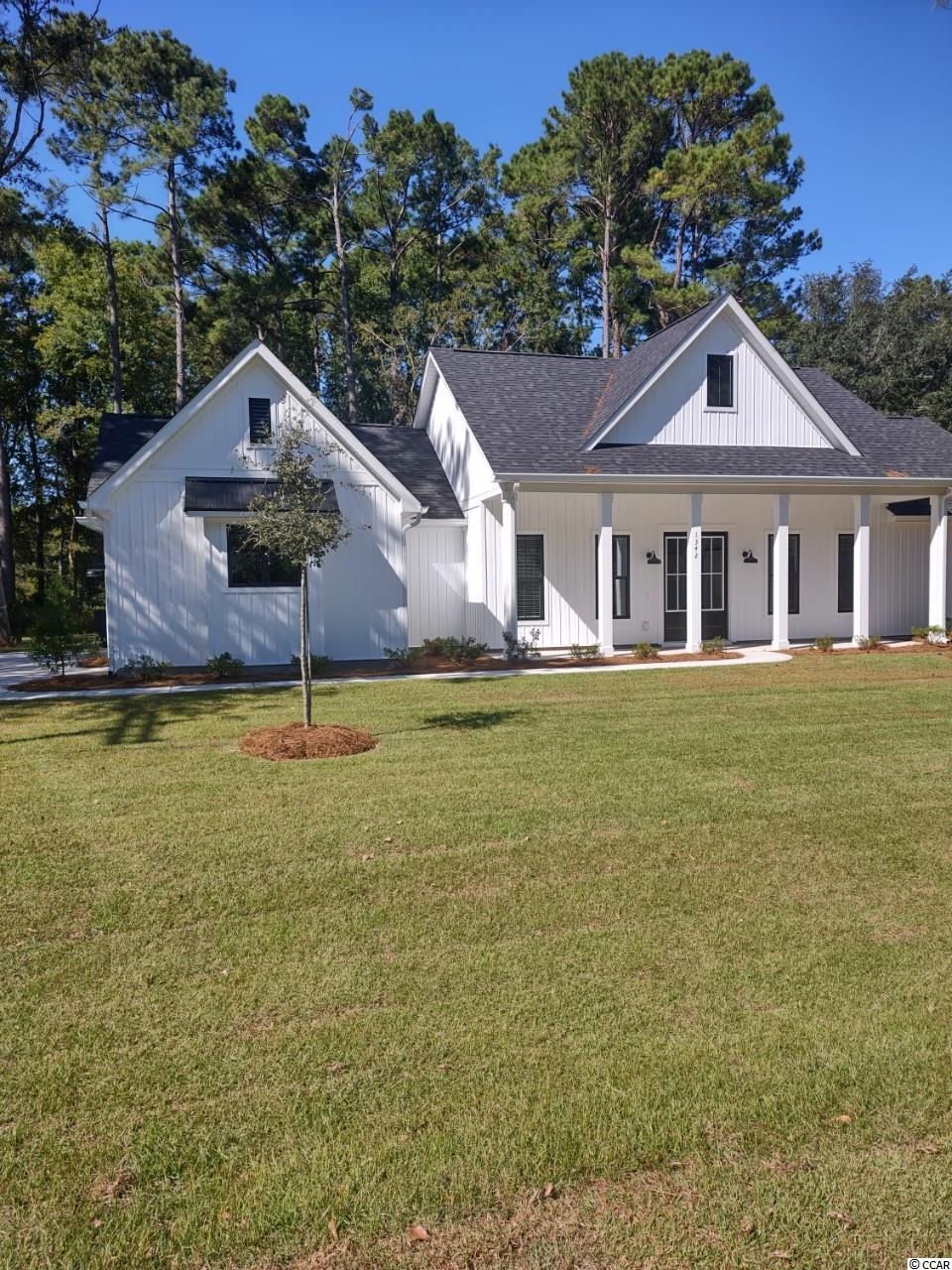 Beautiful 4 bedroom 2.5 bath open concept farm house located within the prestigious Litchfield Country Club.