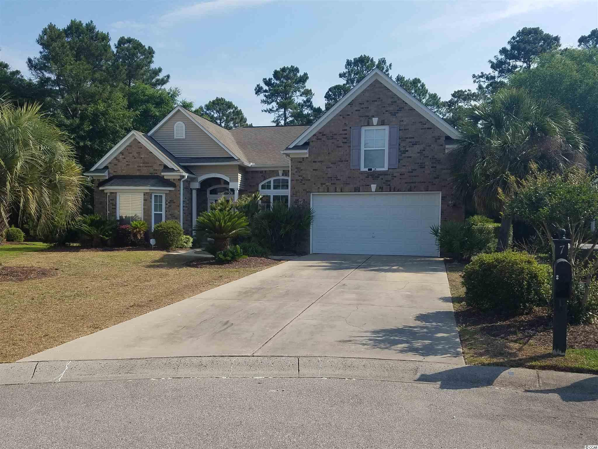Linksbrook in Murrells Inlet!  This 4br/3.5ba brick home sits in a cul-de-sac and has an over 1/2 acre lot. This beautiful home features a brick exterior, a 2 car garage, wood floors, upgraded fixtures, vaulted/tray ceilings with crown molding, a bedroom set up as an office with built in's that will convey, a formal dining room, a huge kitchen with a work island and breakfast bar, and a large finished carolina room.  The amenities in Linksbrook are an outdoor pool, a clubhouse, and tennis courts.