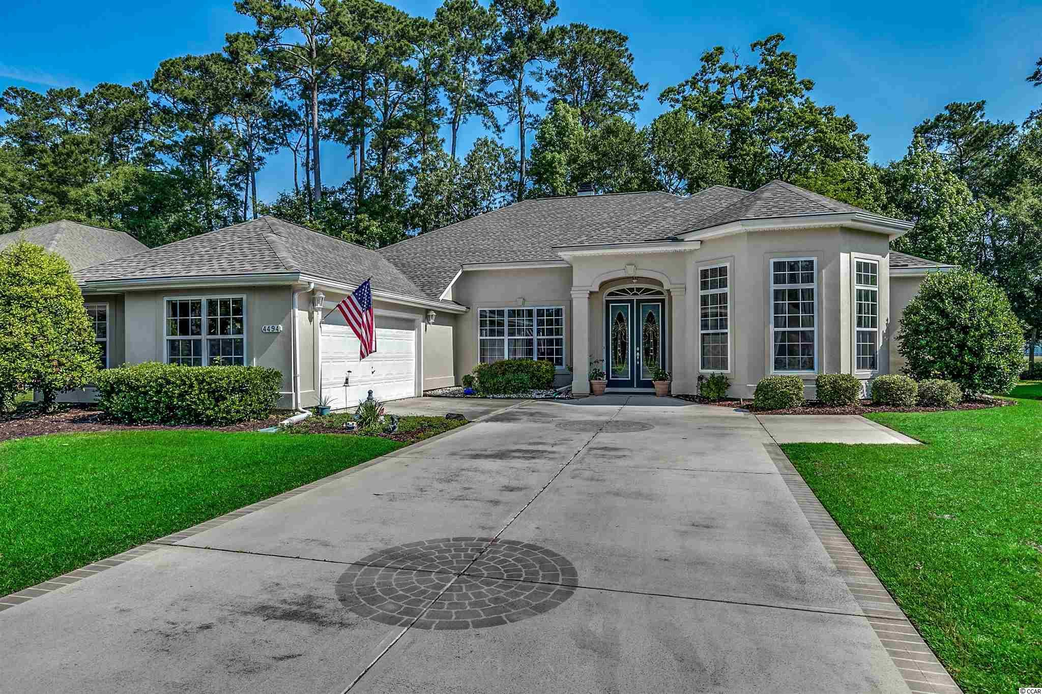 """Immaculate home in desirable gated community of Wachesaw East. Open floor/split bedroom plan, fourth bedroom could be used as a guest suite with private bathroom. Upon entering this beautiful home, you are greeted with foyer, dining room and formal living room with hardwood floors. The large kitchen has a work island, 40"""" cabinets along with appliance pantry. The formal living room has a double sided fireplace shared with the family room. Enter the spacious master bedroom through double doors with large master bath. Large screened in room and outdoor patio overlooking the signature 17th hole. Amenities include pool, gym and security. Near famous Marsh Walk restaurants, Huntington Beach State Park, shopping and Brookgreen Gardens."""