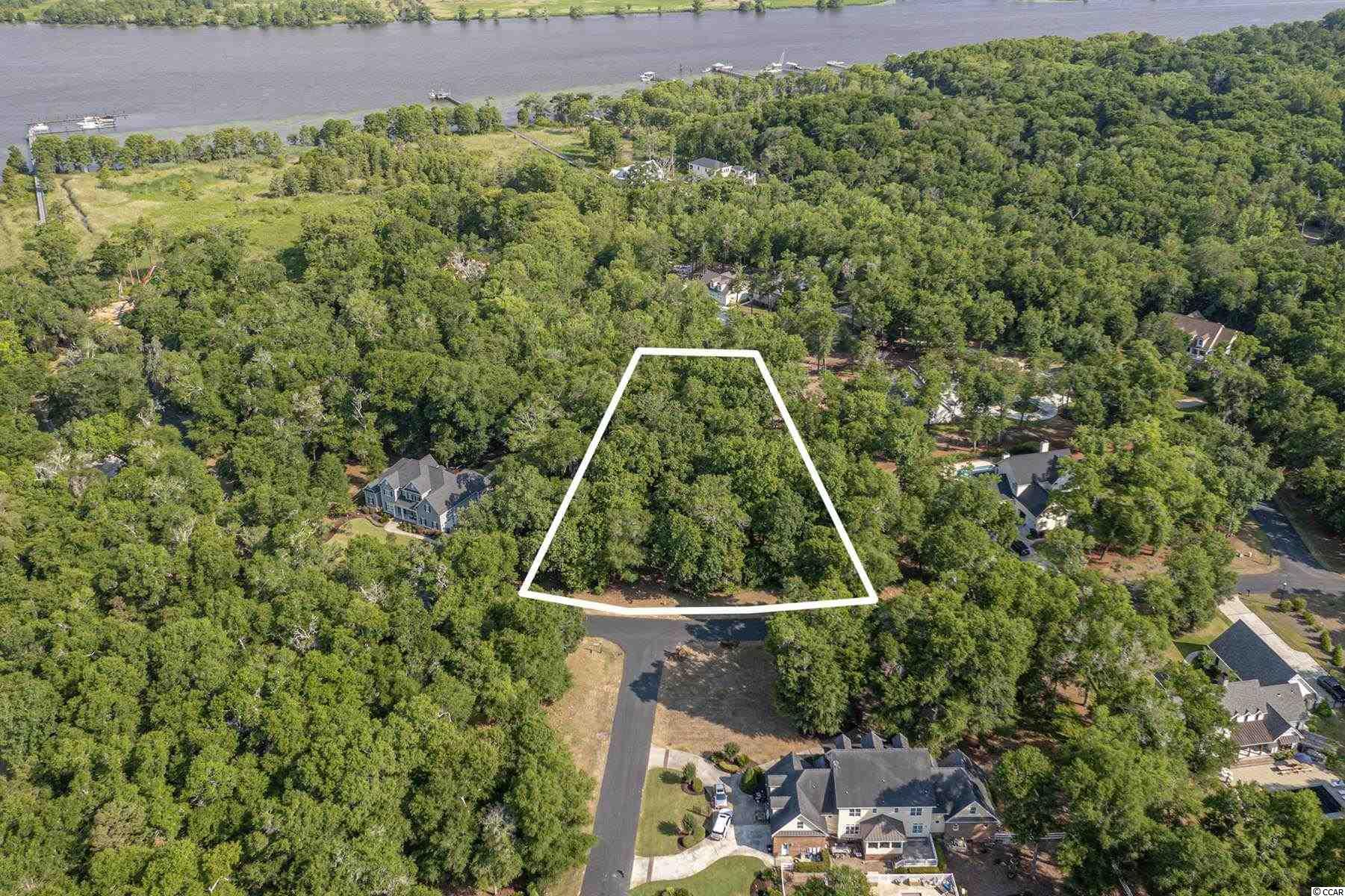 Amazing opportunity to build your very own private estate in one of the most exclusive gated neighborhoods in Pawleys Island, Allston Bluffs ! Lot 6 Susannah Lane is over 1.27+/- Acres and Backs to the common area for extra privacy. In addition, each of the 20 homesites in Allston Bluffs comes with a dedicated boat slip in the community's private Marina ! The Clubhouse Overlooks the Waccamaw River and inside features a wood burning fireplace & full kitchen. It is perfect to host events, parties, and relaxing after a day cruise on the river. The community has the perfect southern charm as it is beautifully lined with live oaks draped in Spanish moss. Just a 10 Minute Drive to Georgetown, short day trip away to historic Charleston, or you can head up north to all the attractions of Myrtle Beach. Close to all the boutique shopping and dining in Pawleys Island. Call today for a showing !