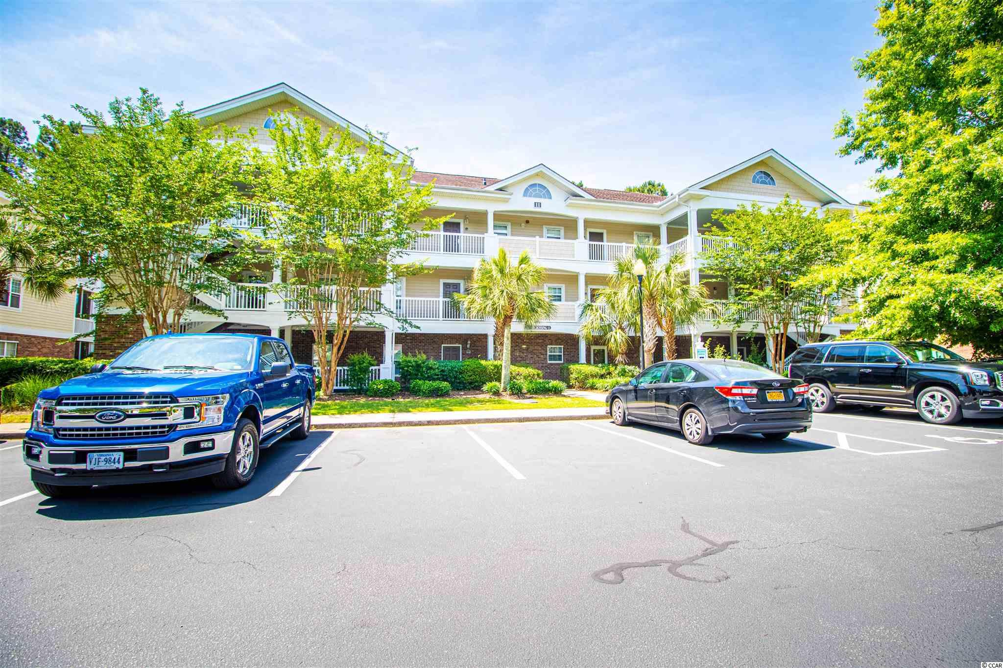 Welcome to carefree living that is convenient to everything! This FIRST FLOOR 2 bedroom and 2 full bath condo is directly across from the pool and ready to move right in! It has huge windows that bring in an abundance of natural light! It is even mostly furnished! Sit on your private back covered patio and enjoy the privacy and golf course views, then walk over to everything at Barefoot Landing and enjoy a cool evening stroll home. The HVAC was replaced in 2017 and the water heater, microwave, and refrigerator, are all new! There is nothing that this unit needs! Call the agent with any questions.
