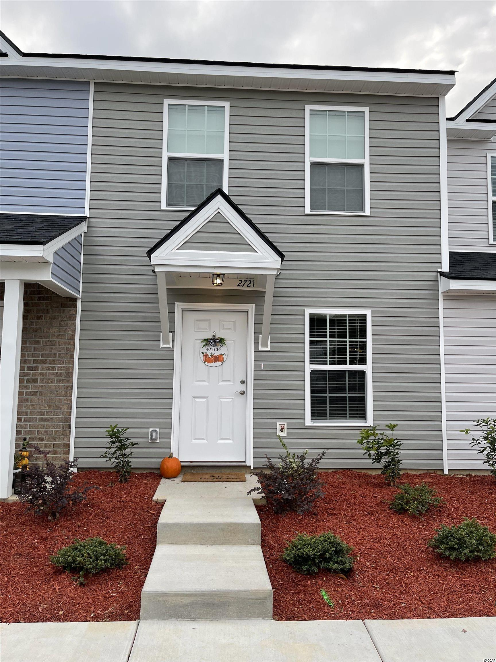 Take advantage of new construction townhomes in an already established neighborhood located minutes from the heart of Conway, South Carolina. Affordable, family living at it's best, the Hartwell floor plan features 2 bedrooms, 2.5 bathrooms with a brick exterior, granite countertops with a stylish backsplash accent, stainless steel appliances, and luxury vinyl plank flooring throughout the main living areas. Not to mention an on-site clubhouse and pool ready for your enjoyment. The idyllic location is situated within minutes from local schools as well as a short 2 mile walk or bike ride to the picturesque, Historic downtown Conway full of activities, shopping and dining. Rentals are allowed, so if you are looking for an investment property, Midtown Village Townhomes are the perfect opportunity to expand your portfolio with a long-term rental or vacation getaway. Construction is underway so schedule a showing today! Square footage is approximate and not guaranteed. Buyer is responsible for verification.