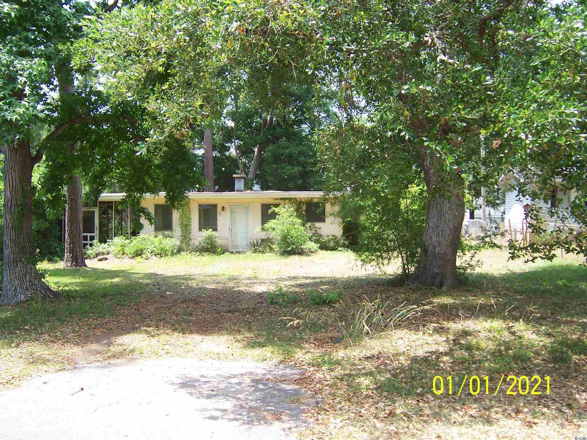 Only 1/2 miles from Atlantic Ocean and Garden City Beach. The structure on the property has no represented value. Property was just surveyed for accuracy. Very level buildable lot.