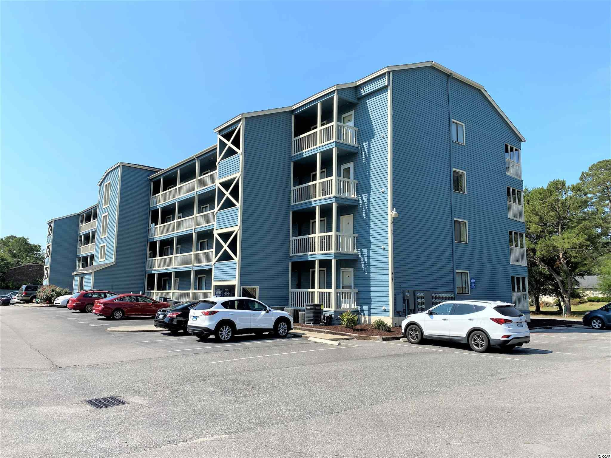 TOP FLOOR condo with an ELEVATOR in the building! The back porch has been turned into a FOUR SEASONS ROOM and the OPEN CONCEPT floorplan gives the home a spacious feel! This has been a very WELL MAINTAINED residence in a very convenient location close to beautiful golf courses and less than 10 minutes to the Cherry Grove Beach! You've got EXTRA STORAGE space across from the elevator. The community pool offers a nice place to relax, and there is bicycle storage on-site.