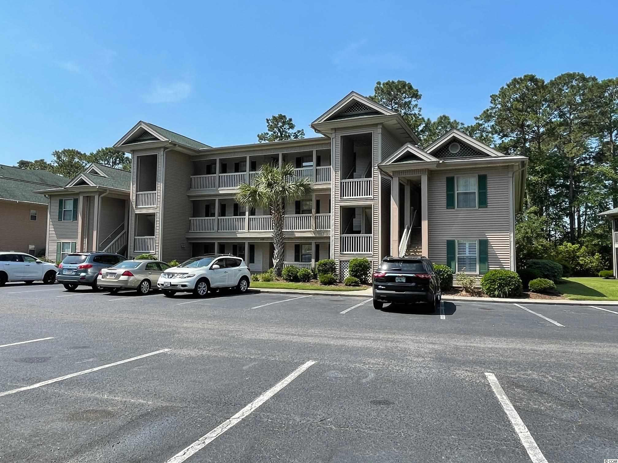 BACK ON THE MARKET!!!  No fault of seller.  This True Blue Condo is a real gem of a find in Pawleys Island. This gorgeous well maintained and fully furnished 3 Bedroom 2 Bath condo with Golf Course Views is sure to not last long.  The condo boasts a large master bedroom with a king sized bed as well as a quest room that also has a king size bed.  The second guest room has two extra long twin beds allowing for fun times for all. The utilization of space in this condo gives you the ability to have guests without being cramped, and it is also designed as a split bedroom plan.  The fully equipped kitchen has new stainless steel co-ordinate Samsung appliances, and is ready to use immediately.  Clean up is a snap as this condo has a full sized washer and dryer located in the large second bathroom, tucked away in a laundry closet. The flooring throughout the main living space is luxury vinyl interlocking floor, with the kitchen foyer and hall covered in ceramic tile.  The bedroom areas are carpeted for your comfort.  If you're looking for amenities, look no further.  This community has multiple pool outdoor living areas and in fact True Blue has 5 pools and 4 hot tubs.  Great venues for walking and enjoying the beautiful surroundings. If tennis sport look no further, as amenities include tennis courts.  This condo is located across from the pool and hot tub that remains open 12 months of the year, for your outdoor enjoyment.  Location, location, location....  The beach is a short 5 minute drive. Golf amenities in your community, with a golf academy located on the property, as well as a clubhouse with dining.  Outside this community Georgetown is only a short drive south. Huntington State Park is only 5 miles north.  Brookgreen Green Gardens and it exhibits are just to the north on HWY 17.   Your general location is close enough for quick visits to Charleston and all the shopping of the South Strand area to the north.