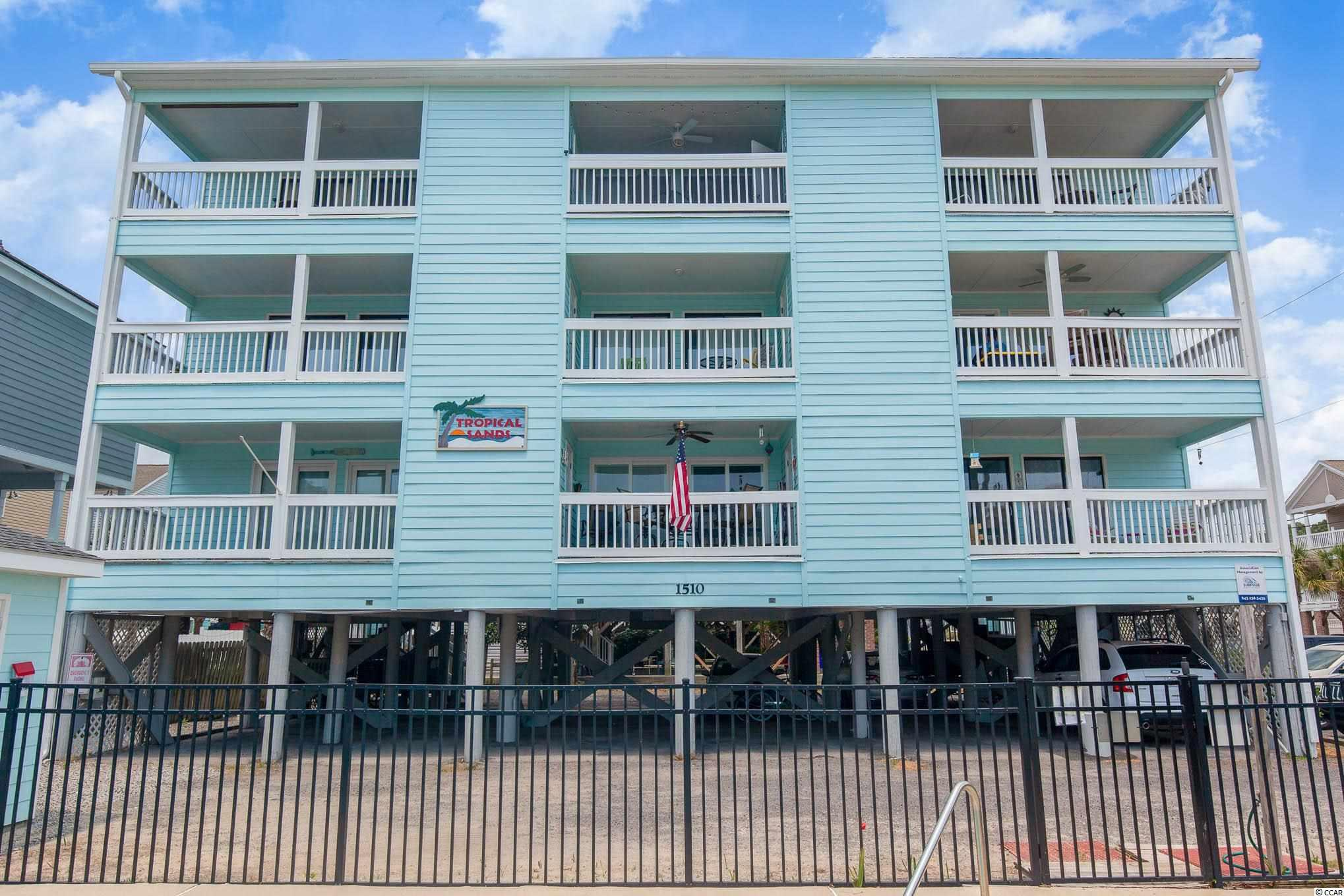 Welcome to Tropical Sands in the heart of Surfside Beach!  Unit 101 is a two bedroom/one bath condo with an ocean view!  This is a 2nd row complex on the corner of 15th Ave S and Ocean Blvd with beach access directly across the street. Unit 101 is a first floor walk up that has been completely renovated from head to toe.  Extra large balcony for dining and relaxing.  Master bedroom enclosed to make this a true 2 bedroom.  The kitchen has new cabinets, white subway tile, and quartz countertops.  LVT Flooring throughout.  Tropical Sands has a pool for the 9 units as well as ample parking.  The exterior has just recently been painted and the building is overall well maintained and managed!  Golf cart up to the Surfside Pier, River City Cafe, or Conch Cafe.  Short drive to the Murrells Inlet Marshwalk or the Myrtle Beach Airport.  This is the perfect beach getaway spot to keep for your 2nd home or use for a rental investment.  Call your Realtor today to schedule a showing!  Sold partially furnished, ask your agent for the list.  Square footage is approximate and not guaranteed. Buyer is responsible for verification.