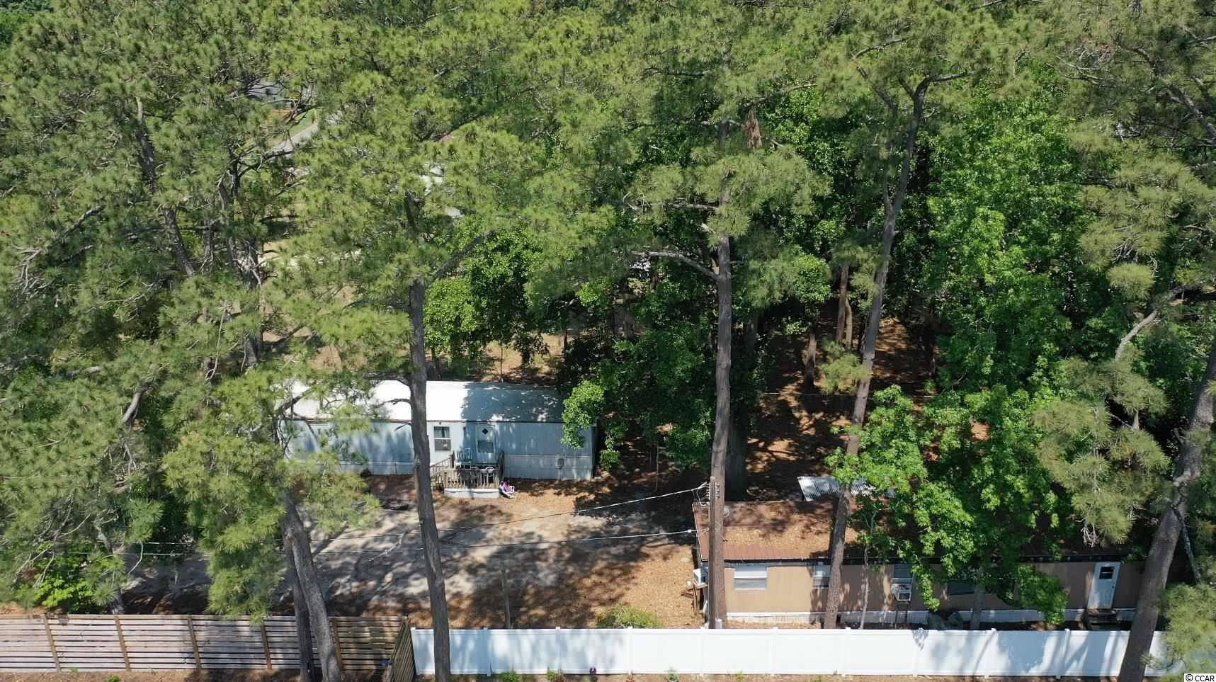 This wooded lot offers two income producing single wide manufactured homes and easy access to the boat landing at the end of Stanley Drive. First home includes two bedrooms and two baths with the second home presenting two bedrooms and a single bath. This property affords you easy access to the beach and golfing along with all of the other activities and happenings in Myrtle Beach & Murrells Inlet including fun eateries, award winning off-Broadway shows, public fishing piers, Marsh Walk, and intriguing shopping adventures along the Grand Strand. Conveniently located to your everyday needs, including grocery stores, banks, post offices, medical centers, doctors' offices, and pharmacies.