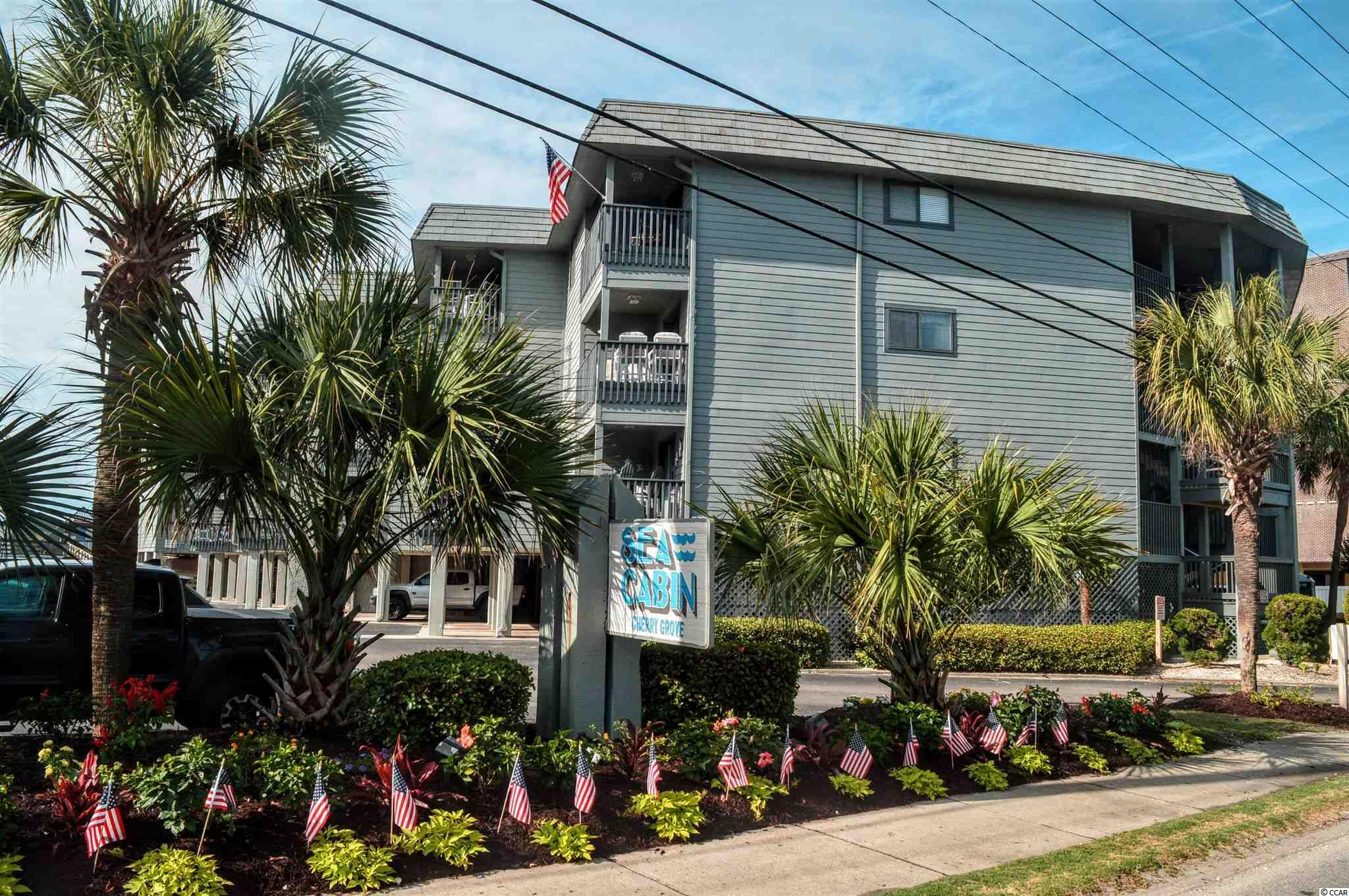 """This ocean front condo is located in the very popular """"Sea Cabin"""" complex located near the desirable Cherry Grove Point. Unit 104 has a great ocean front balcony and is on the first floor so it has fewer steps to the front door. It has a full kitchen, den, one bedroom and one bath.  The unit is set up to accommodate approx. 6 guests using the bedroom queen, an additional bunkbed and a sofa. The HVAC and Hot Water unit were updated in 2019!! This home has excellent rental history with documentation available. Sea Cabin amenities include a nice swimming pool on the property as well as a private pier for the use of the owners and their guests. The complex has laundry rooms located in or near each building and unit 104's laundry is conveniently located on the same floor and just a few steps away. There are 2 parking places allowed for each unit and there is space for some of the property owners to keep a golf cart. The complex has 2 convenient beach access walkways and water spigots are available nearby so you can rinse your feet and chairs when you return. The HOA dues provide the condo owners with water, sewer, trash, cable, internet, grounds maintenance, pool maintenance, pest control, building insurance (excluding HO6), and management fees. The beautiful beachfront Sea Cabin complex in Cherry Grove is a more laid back and quiet section of North Myrtle Beach but is still super convenient to popular shopping areas, numerous top quality golf courses, live entertainment and dance venues, sports complexes, amusements of every description, and of course hundreds of awesome restaurants! 6000 N. OCEAN BLVD. UNIT #104 NORTH MYRTLE BEACH, SC (SEA CABIN~A COUPLE BLOCKS FROM The Cherry Grove Point!)  **Listing agent has a quick video taken inside unit for anyone needed a video ask agent for it to be texted** Contact your agent for full details on Rules/ Regulations and full details on Sea Cabin (Listing Agent has lots of information provided)."""