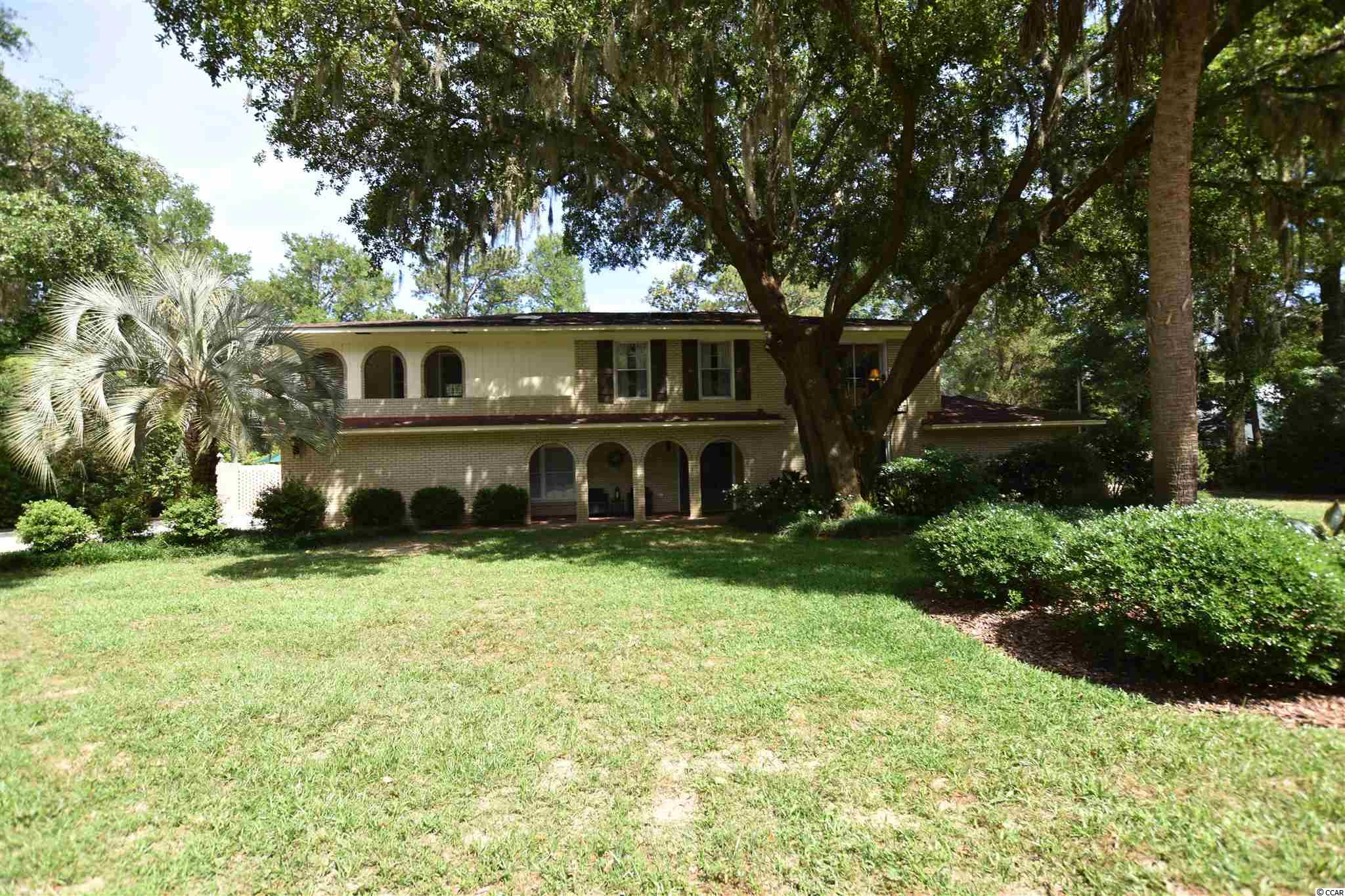 Incredibly unique opportunity to own on the water in Pawleys Island.  This delightful abode boasts a spanish style with a lowcountry twist you are bound to fall in love with. Immediately as you enter the stately front door you will feel as if you've found home. The spacious family room boasts soaring ceilings with an impressive two story fireplace. Lounging in the living area, you will also note calming views of the 8ft dep saltwater pool, mature palms and live oak trees. A 14' x 16' patio off the porch outside the Carolina room offers a propane gas fire pit and walkway to the waterfront deck area with floating dock.  Enjoy direct access to the Waccamaw river (intercostal waterway) from your back yard! The deck/dock area houses full electric power and lights. -- There is no mandatory HOA in Hagley Estates so you are free to store your RV or Boat on the property.