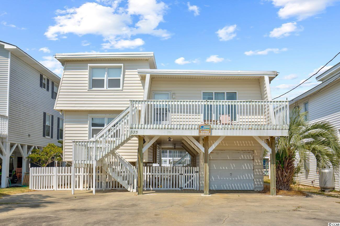 Wow! Check out this one-of-a-kind channel home in Cherry Grove. Magnificent water views. This four bedroom, two bath home is only three short blocks from the beach. Offering a very unique floor plan with a large living space and huge sun room. Perfect for a primary residence, vacation home, or investment. This home has it all. This is truly a Must SEE. Schedule your private showing Today.