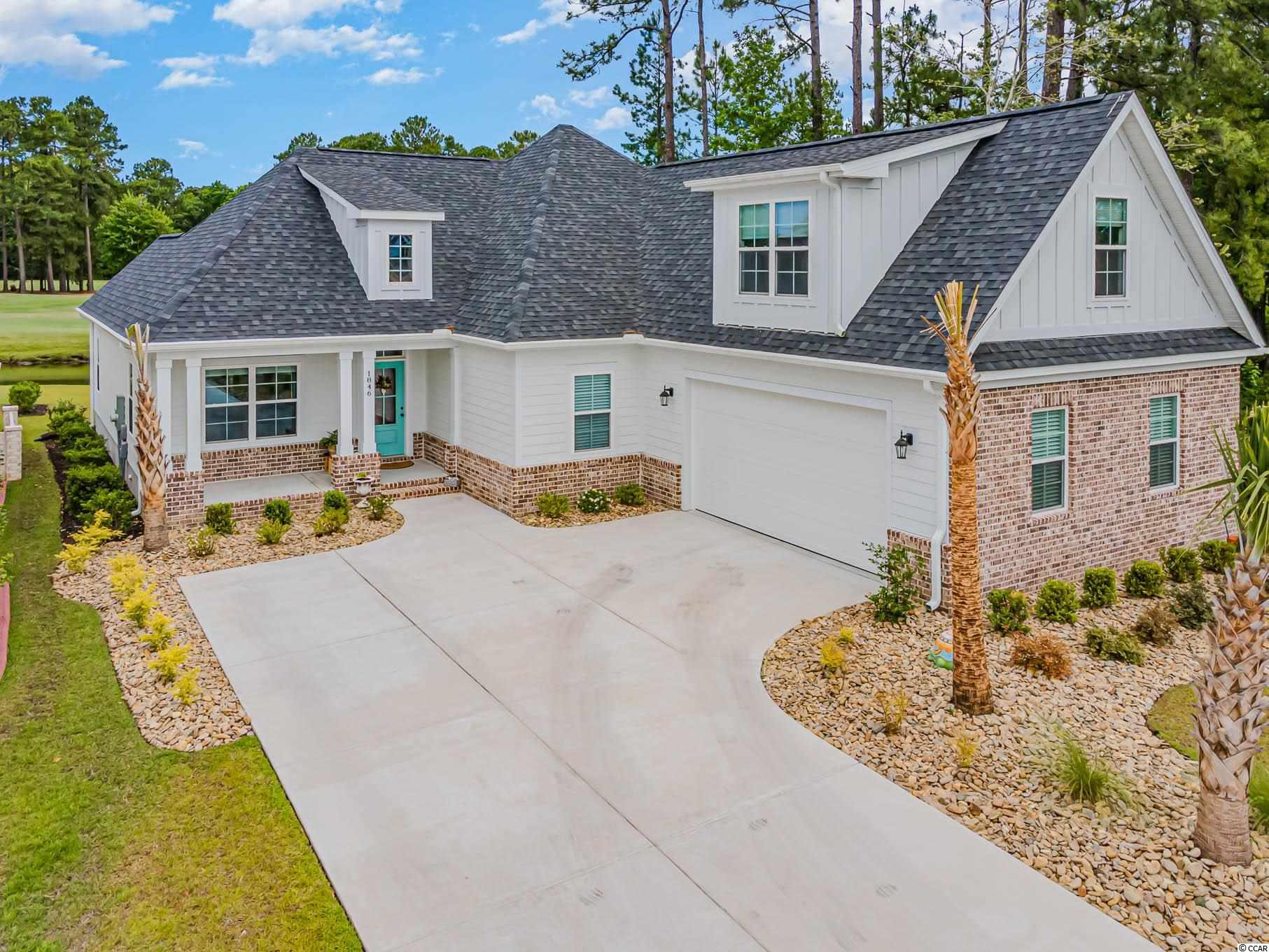 Immaculate custom-built home in Wild Wing Plantation by Richardson Custom Homes! This quality-built, luxury home boasts many features and is close to the beach. Entering the home, you will notice all the custom features,  PRYZM rigid core floors by Armstrong Flooring, and on-trend, coordinated lighting. The entryway and formal dining room are accented with wainscoting panels that add a touch of elegance. Next, an open kitchen and living room floor plan with exquisite lines. The eat-in kitchen features complementary quartz countertops, a large working island, Samsung stainless steel appliances, a gas range and soft-closing cabinets. The living room has a coffered ceiling and gas fireplace with a shiplap accent. The sliding glass doors in the living room flood the space with natural light. Just outside is the patio, where you can enjoy your morning coffee looking out at the golf course and water views. The primary bedroom towards the back of the home offers the same golf course views. A shiplap accent wall and tray ceiling make a statement. The en-suite bath boasts a tiled shower with a rain showerhead, a dual vanity, and two walk-in closets. The other 2 bedrooms are tucked away towards the front of the home and offer privacy for guests. Relish in relaxation in the spacious, finished family room above the garage. This could serve as a home office, theater, or even home gym. Store your cars in the 2-car garage, which has a custom screen to enjoy breezy days. This home is a MUST SEE and has it all!   Wild Wing Plantation offers two award-winning golf courses, practice facility, pro-shop and restaurant. Amenities include 2 large pools, a hot tub, a child swimming station and waterslide, pickle ball/tennis courts, basketball courts, and a playground. The community is right off Highway 501 and close to endless shopping, dining, attractions and Coastal Carolina University. Square footage is approximate and not guaranteed. Buyers responsible for verification. New constructio