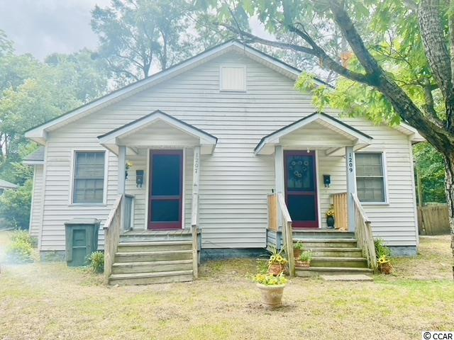 Unique opportunity to own a duplex in Downtown Conway. Location is excellent to schools and shopping. In need of repair work but excellent income potential.