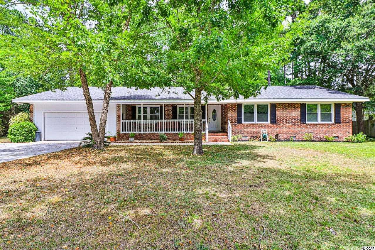 Don't miss out on this incredible opportunity! This beautiful all brick, 3 bedroom, 2 full bathroom family home is located on almost a full half acre of land and features a spacious, bright, and open floor plan! The fully renovated kitchen features lovely white cabinetry, custom tile backsplash, an island counter with a breakfast bar, granite counter tops, and stainless steel appliances plus a formal dining area! The comfortable living room features lots of natural light and gleaming floors! The elegant master suite boasts a large walk-in closet and an impressive master bathroom! You will enjoy the spectacular weather from the relaxing front porch overlooking the peaceful setting! Being in such a great location, not only are you just minutes to the beach, but you are also only minutes to Market Commons, Tanger Outlets, Coastal Grand Mall, delicious restaurants, shops, and so much more! Book your showing today!
