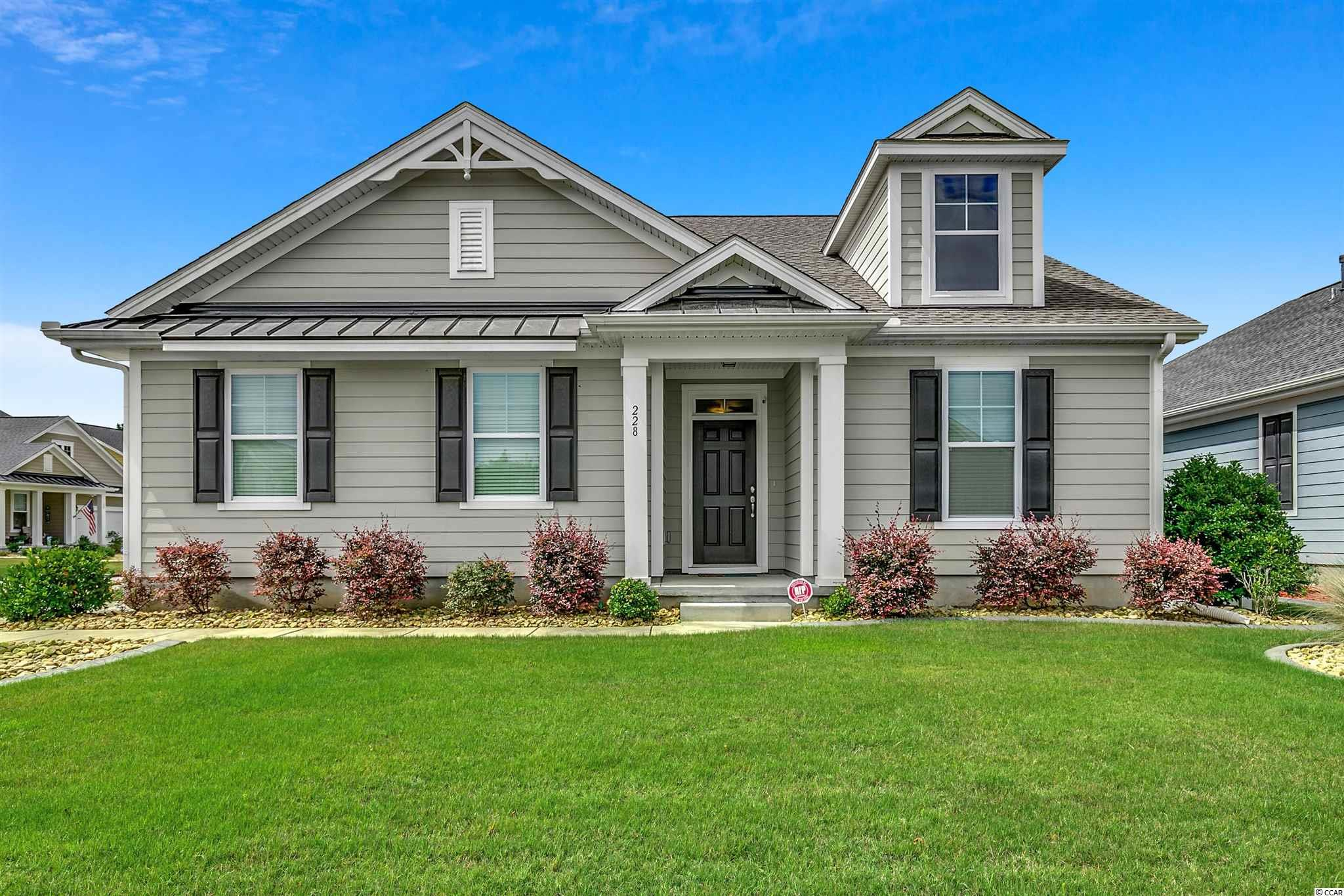 This IMMACULATE home is located in the desirable Prince Creek area of Murrells Inlet within walking distance to South Carolina's only TPC Golf Course. It has only been used as a vacation home with 3 bathrooms, 3 bedrooms, PLUS an office, PLUS a second living area upstairs that could be the 4th bedroom. Features include Natural Gas tankless water heater, stove, and fireplace, upgraded cabinets, quartz countertops in kitchen and all 3 bathrooms, beautiful tile backsplash, tile in all wet areas, beautiful tiled shower in Master Bath, wood flooring throughout main level of home, stainless steel appliances, a large screened porch and a  12x12 concrete pad for outdoor grilling. The community pool is located just down the street from your new home. This community is conveniently located near shopping, restaurants, golf courses, beaches, inlet, and marinas. A Great place to call home!!! LOCATION, CONDITION, AND PRICE, this home has it all