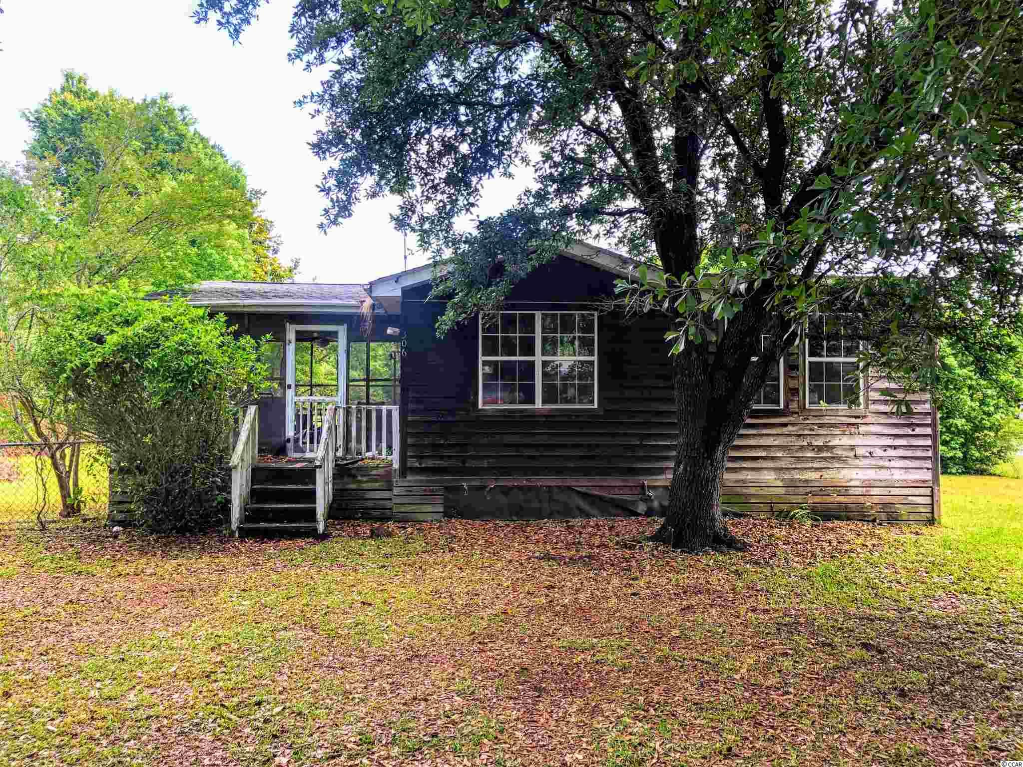 If you are looking for a fixer upper or want to build your dream home in the highly desirable area of Pawleys Island, then look no further! Just minutes from the beach, this 2 bed, 2 bath manufactured home is ready to be brought back to life. Sitting on 0.34 acres, the possibilities of what can be achieved are endless. Home is being sold as-is and features a fenced in yard, large car port, 2 sheds and best of all, NO HOA. The location is perfect, with many fantastic restaurants, shopping, grocery stores and much much more. All measurements and square footage are approximate and not guaranteed. Buyer responsible for verification. Schedule your showing today!